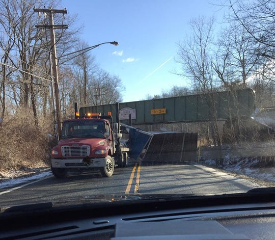 Berkshire Valley Road in Roxbury was closed Thursday morning, February, 28, 2019, when a tractor-trailer truck scraped the underside of a railroad overpass.