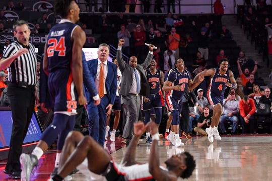 Auburn players react after a possible game tying-shot by Georgia Bulldogs guard Tyree Crump (on floor in foreground) missed in the last second during the second half at Stegeman Coliseum on Feb. 27, 2019, in Athens, Ga.