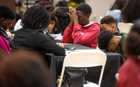 Students bow their heads in prayer during the Youth Forum held at Faulkner University in Montgomery, Ala., get their turn to speak on Thursday February 28, 2019.