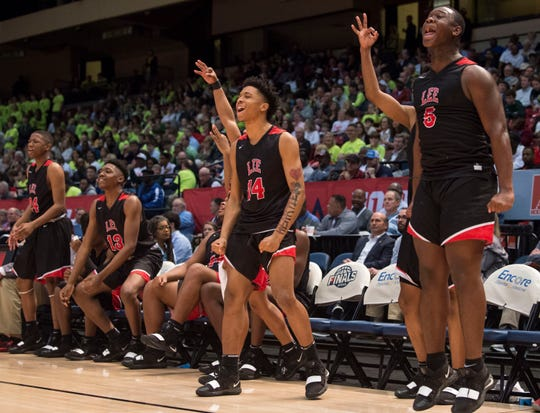 Lee's bench reacts to a three pointer during the Class 7A state semifinal at Legacy Arena in Birmingham, Ala., on Thursday, Feb. 28, 2019. Mountain Brook defeated Lee 59-48.
