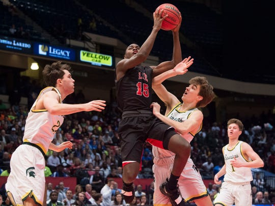 Lee's De'Marquiese Miles (15) goes up for a layup during the Class 7A state semifinal at Legacy Arena in Birmingham, Ala., on Thursday, Feb. 28, 2019. Mountain Brook leads Lee 24-21 at halftime.