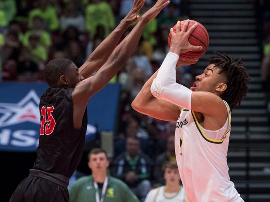 Mountain Brook's Trendon Watford (2) goes up for a layup over Lee's De'Marquiese Miles (15) during the Class 7A state semifinal at Legacy Arena in Birmingham, Ala., on Thursday, Feb. 28, 2019. Mountain Brook defeated Lee 59-48.