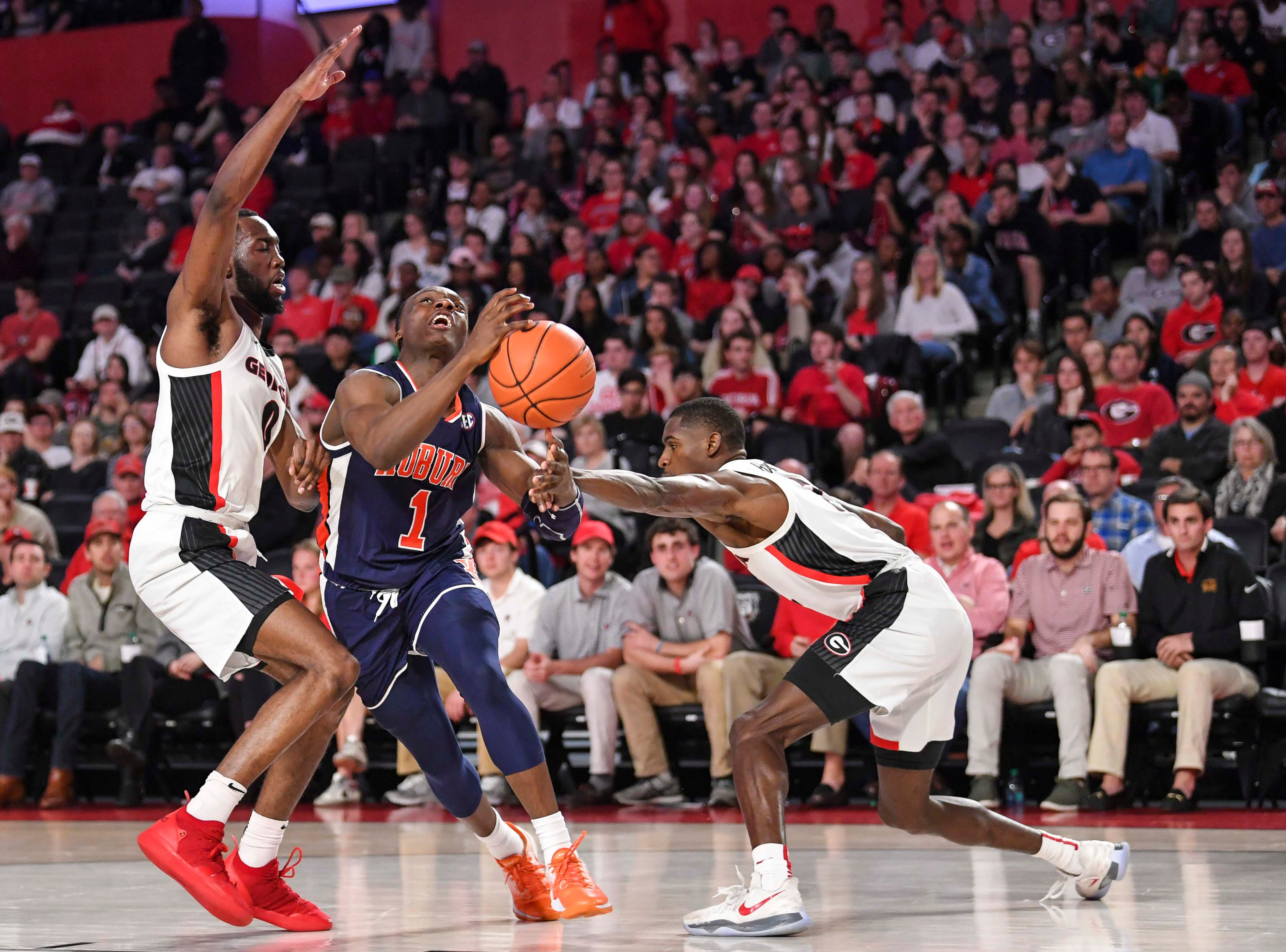 Feb 27, 2019; Athens, GA, USA; Auburn Tigers guard guard Jared Harper (1) looses the ball against Georgia Bulldogs guards William Jackson II (0) and Jordan Harris (2) during the first half at Stegeman Coliseum. Mandatory Credit: Dale Zanine-USA TODAY Sports