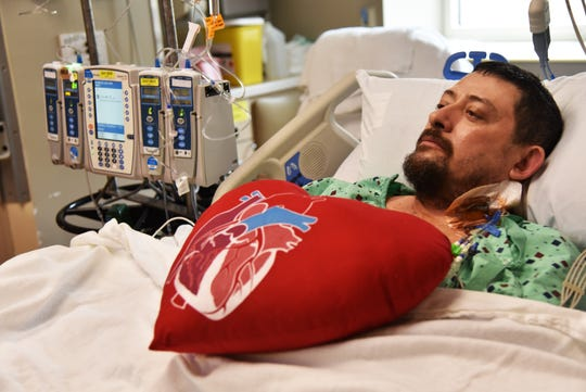 Chad Walker lays in a hospital bed shortly after his heart transplant.