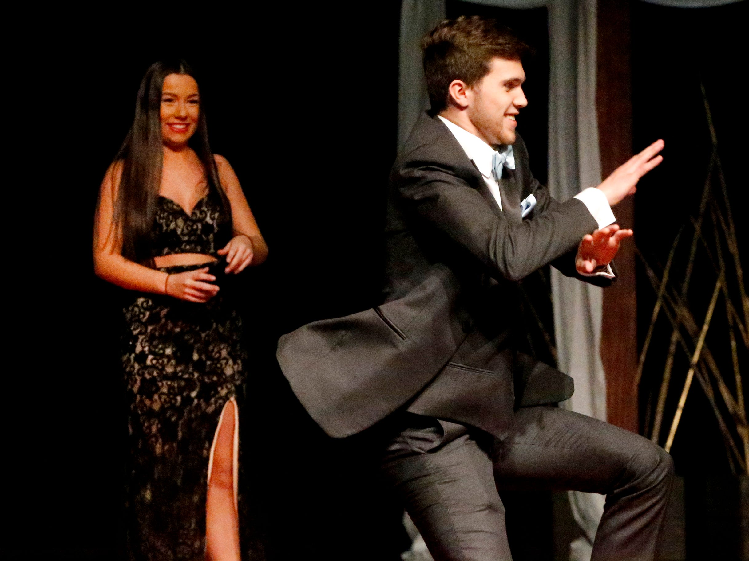 Connor Beckham steps forward and dances at the end of the runway as he shows off his tux after Whitney Tallant modeled her dress during the Siegel Prom Fashion show on Thursday, Feb. 14, 2019.