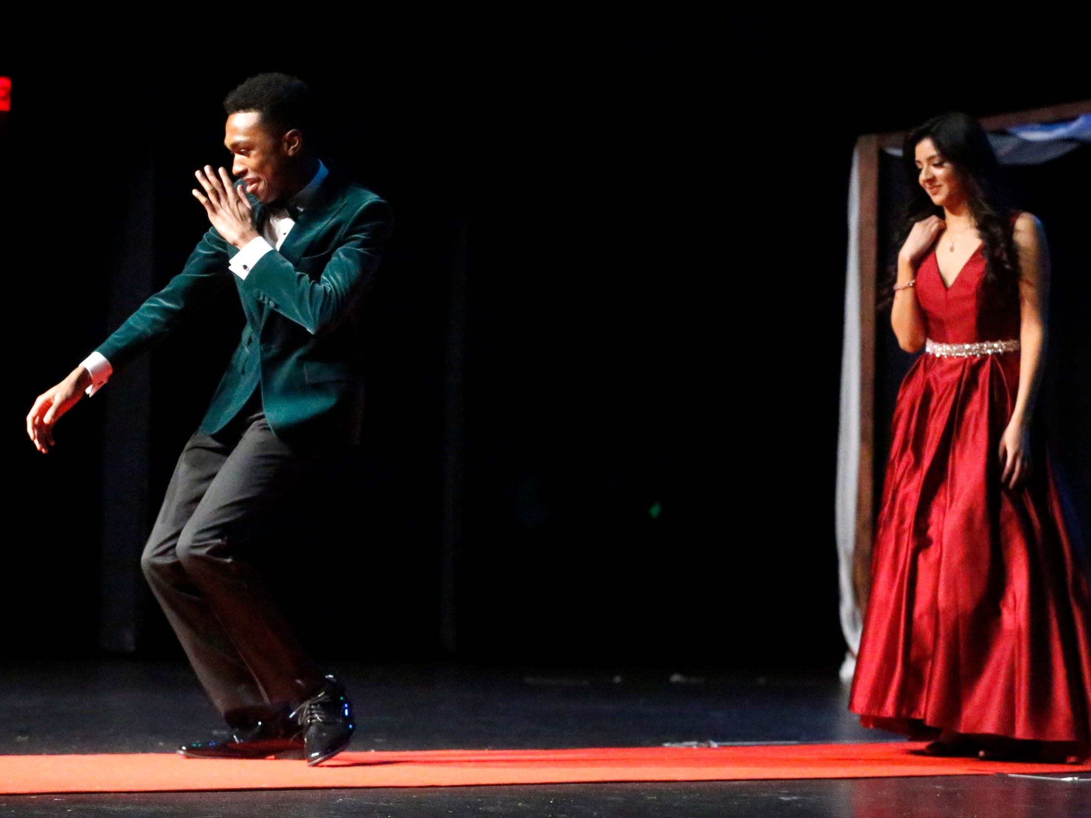 Reggie Stuart dances down to the end of the runway after Yadira Nieto shows off her dress during the Siegel Prom Fashion show on Thursday, Feb. 14, 2019.