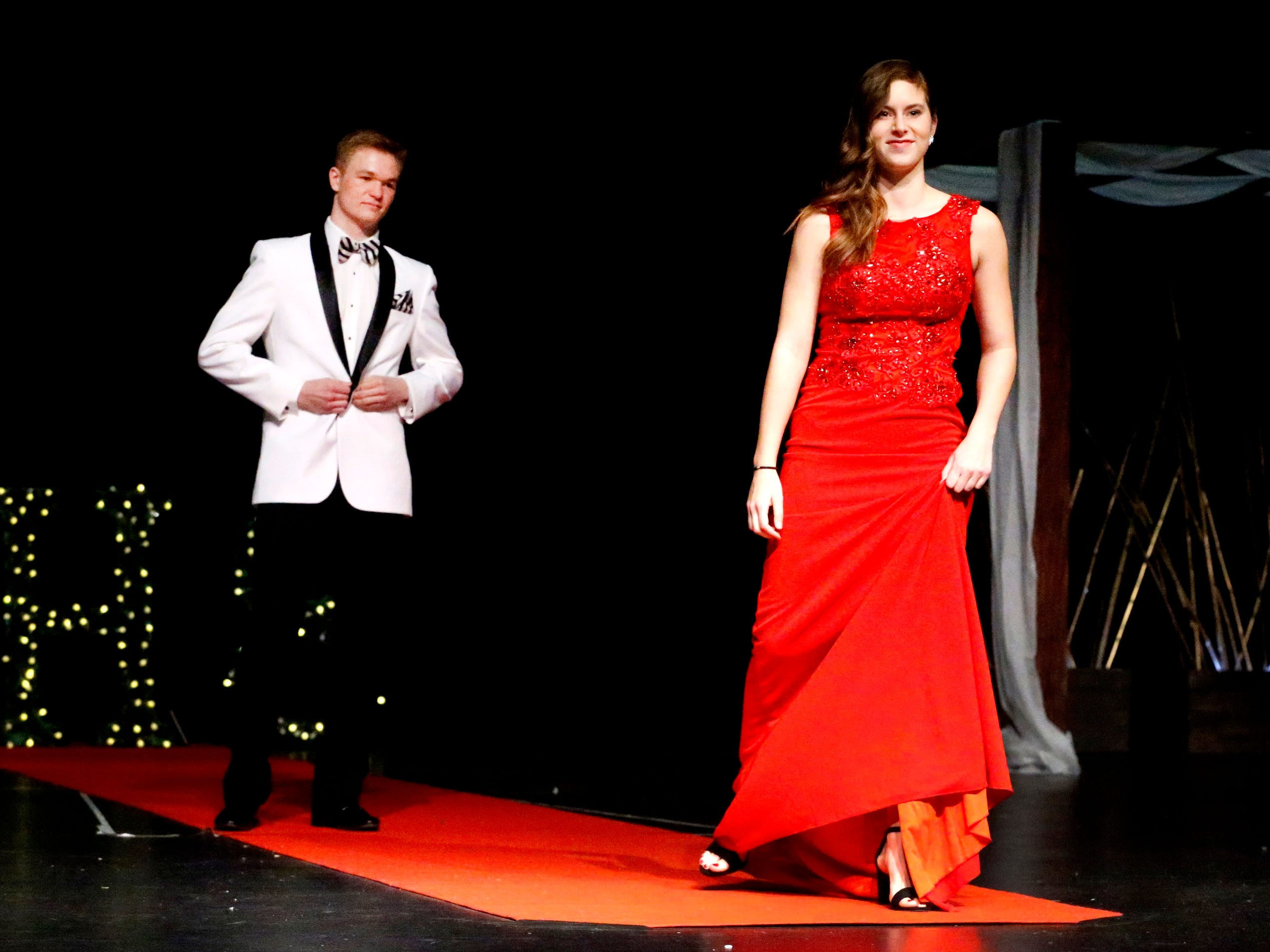 Reannah Remkus steps forward to show off her dress as Tristan Baker waits to show off his tux during the Siegel Prom Fashion show on Thursday, Feb. 14, 2019.