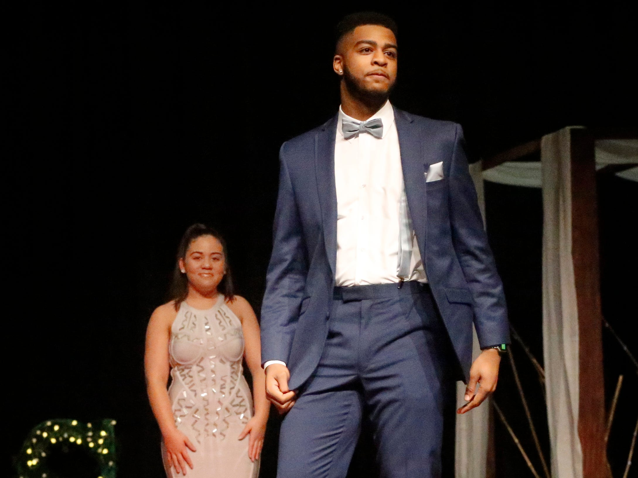 Joseph Howard steps forward to show off his tux after Sierra Cruz modeled her dress during the Siegel Prom Fashion show on Thursday, Feb. 14, 2019.