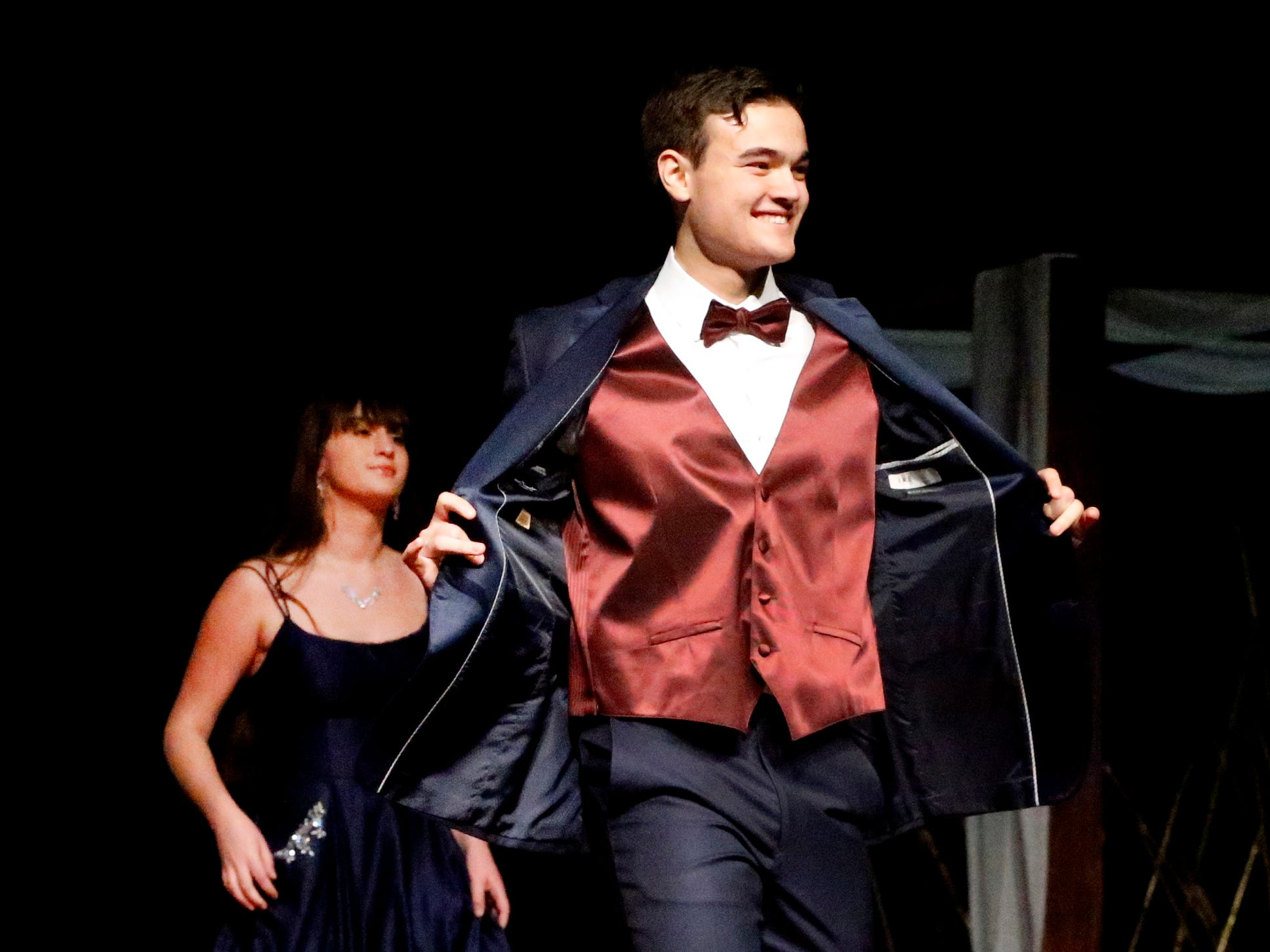 Zane Furqa shows off his tux at the end of the runway during the Siegel Prom Fashion show on Thursday, Feb. 14, 2019.