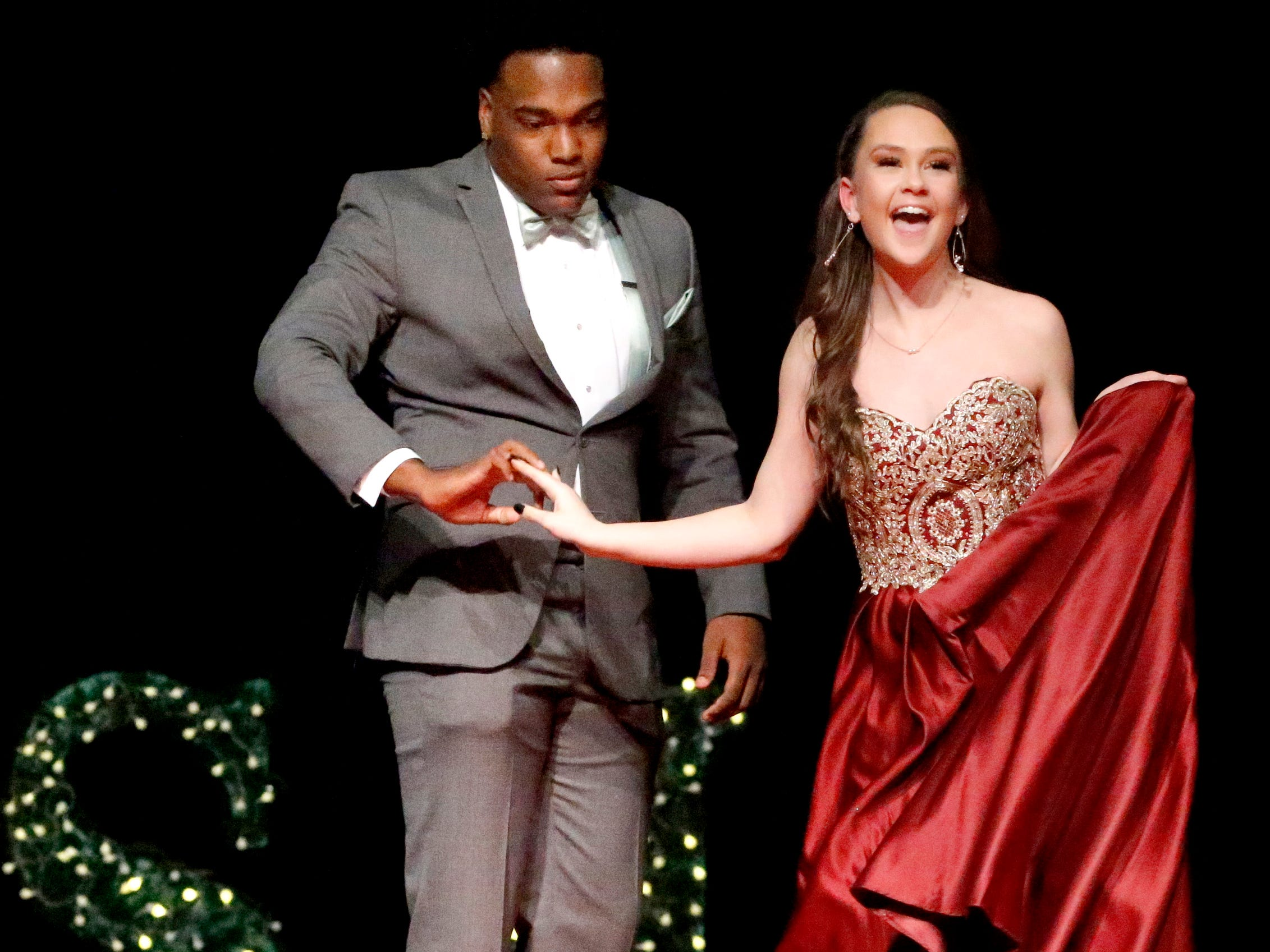 Shamar Vanzant, left and Jinni McCullough, right show off the latest in prom fashions during the Siegel Prom Fashion show on Thursday, Feb. 14, 2019.