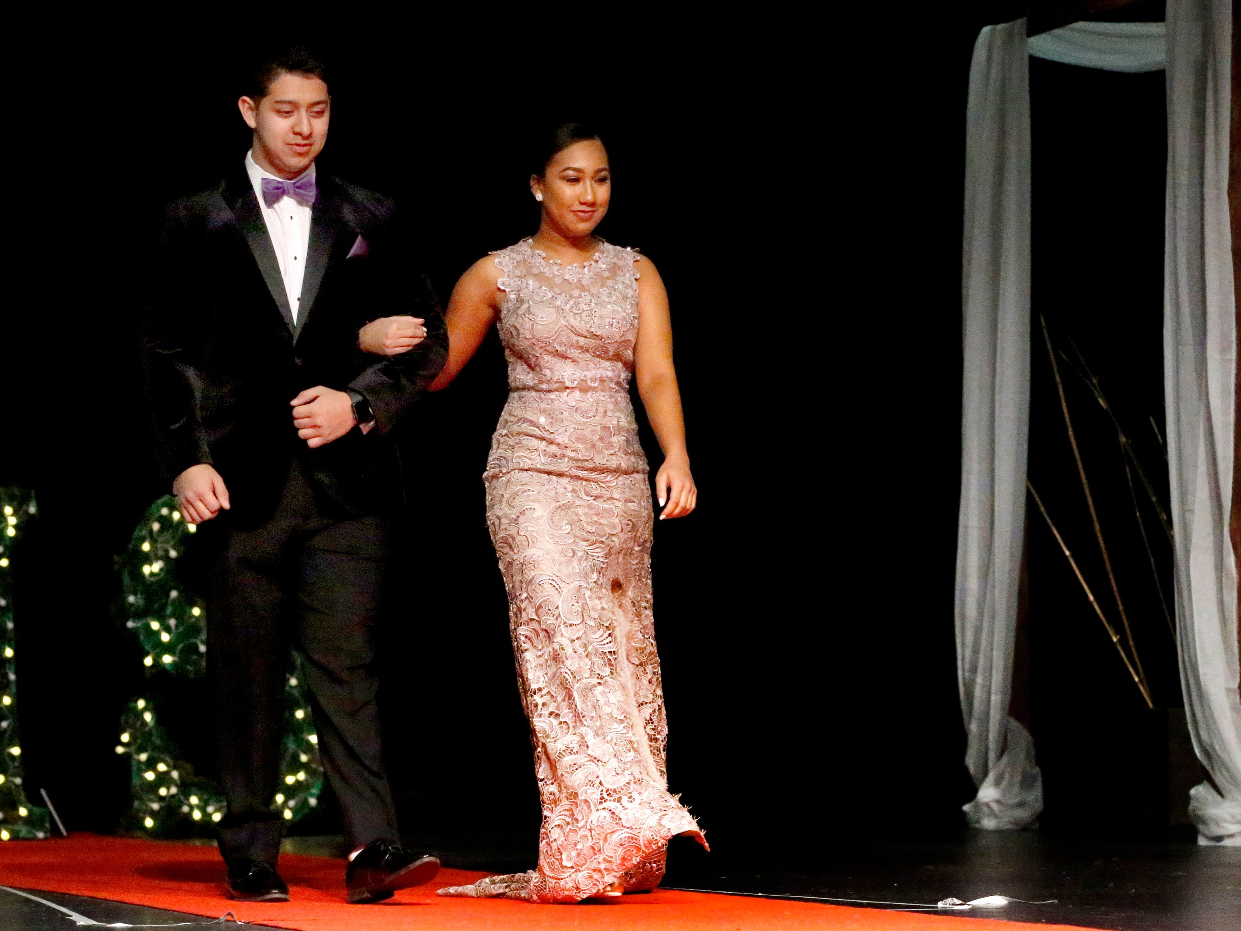 Chris Palacios, left and Aleah Carter, right show off the latest in prom fashions during the Siegel Prom Fashion show on Thursday, Feb. 14, 2019.