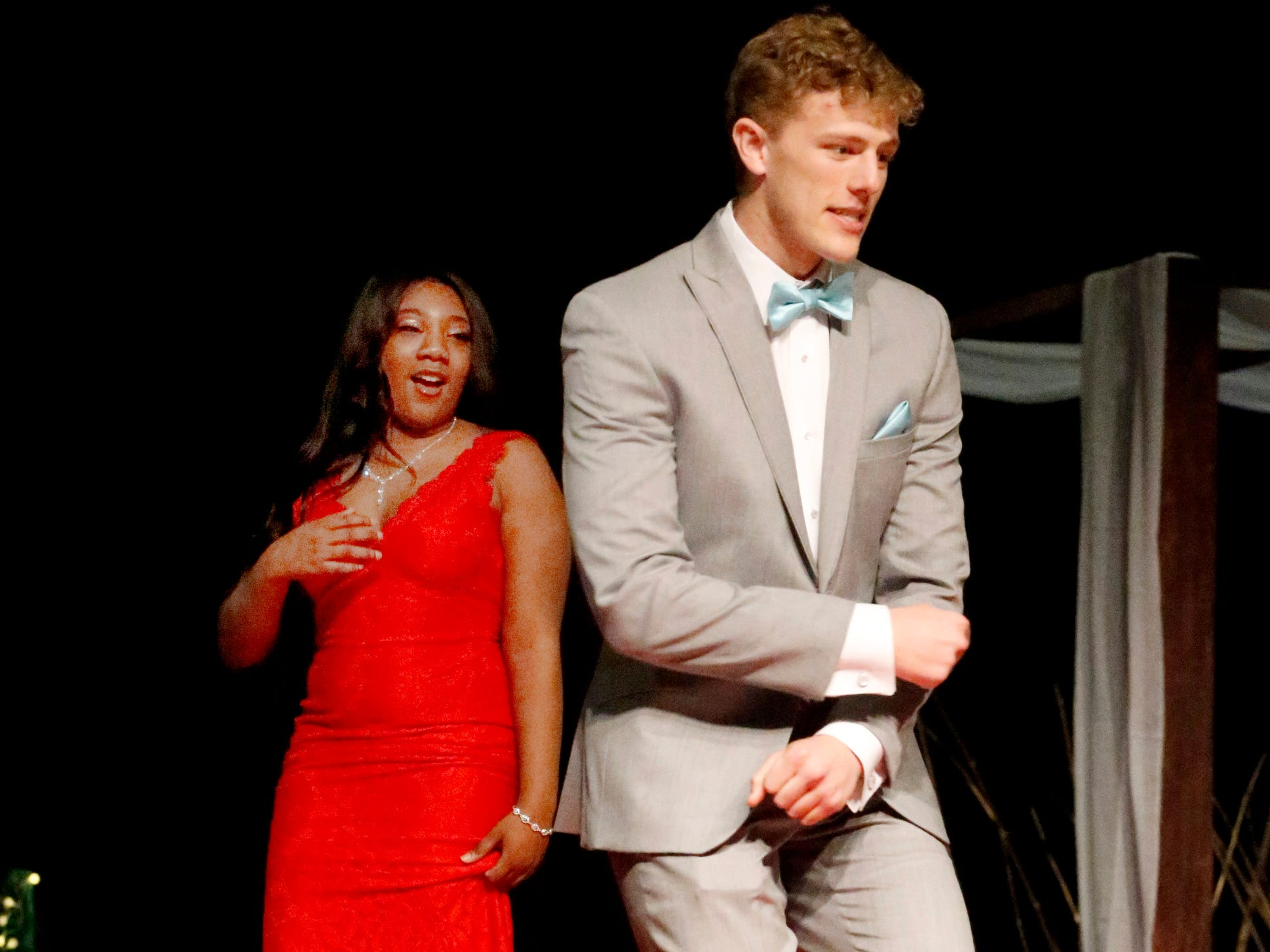 Patrick Moss dances at the end of the runway as Kayla Daniels looks on as they participate in the Siegel Prom Fashion show on Thursday, Feb. 14, 2019.