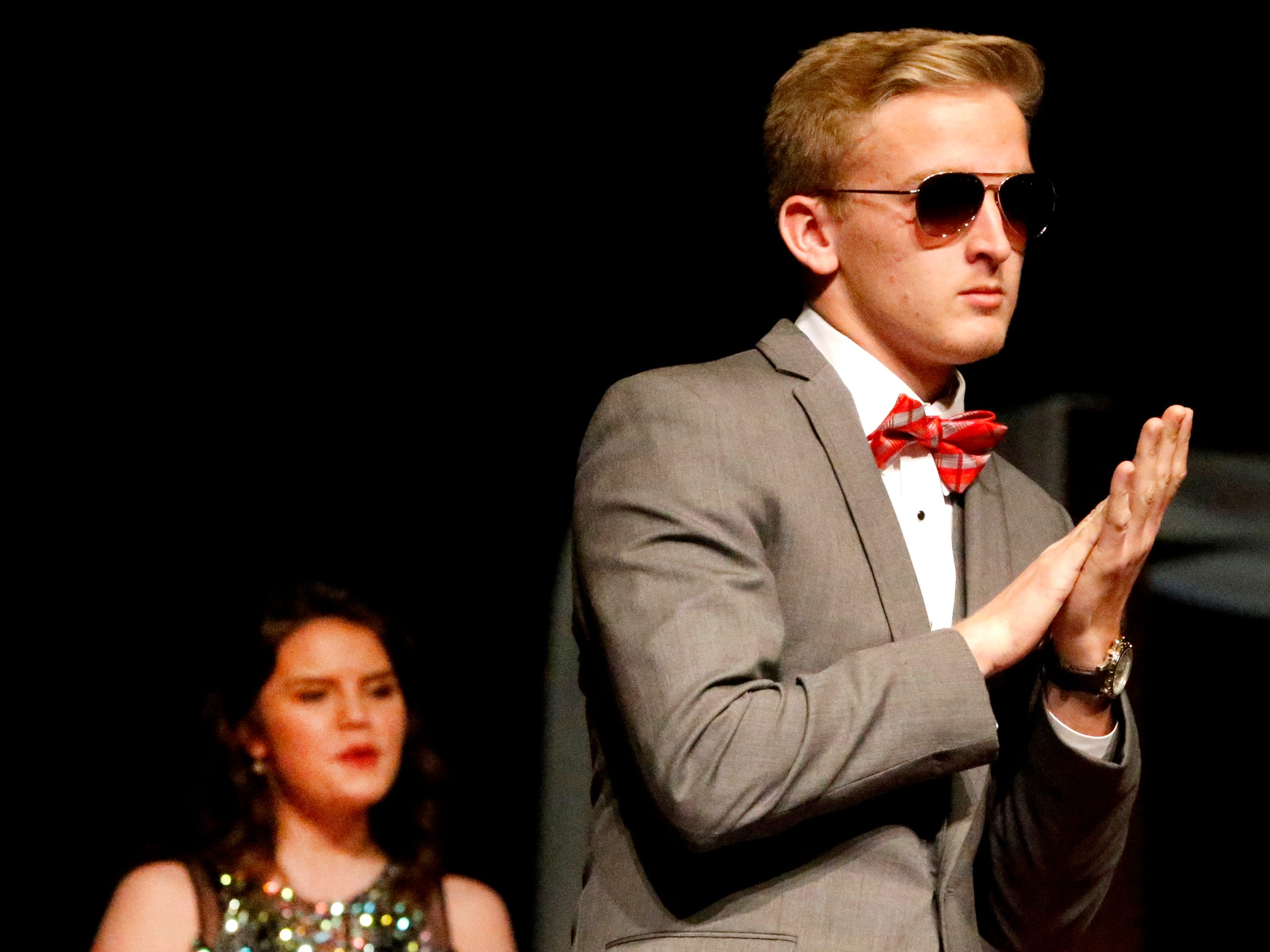 Jaden Lasley shows off his tux at the end of the runway during the Siegel Prom Fashion show on Thursday, Feb. 14, 2019.
