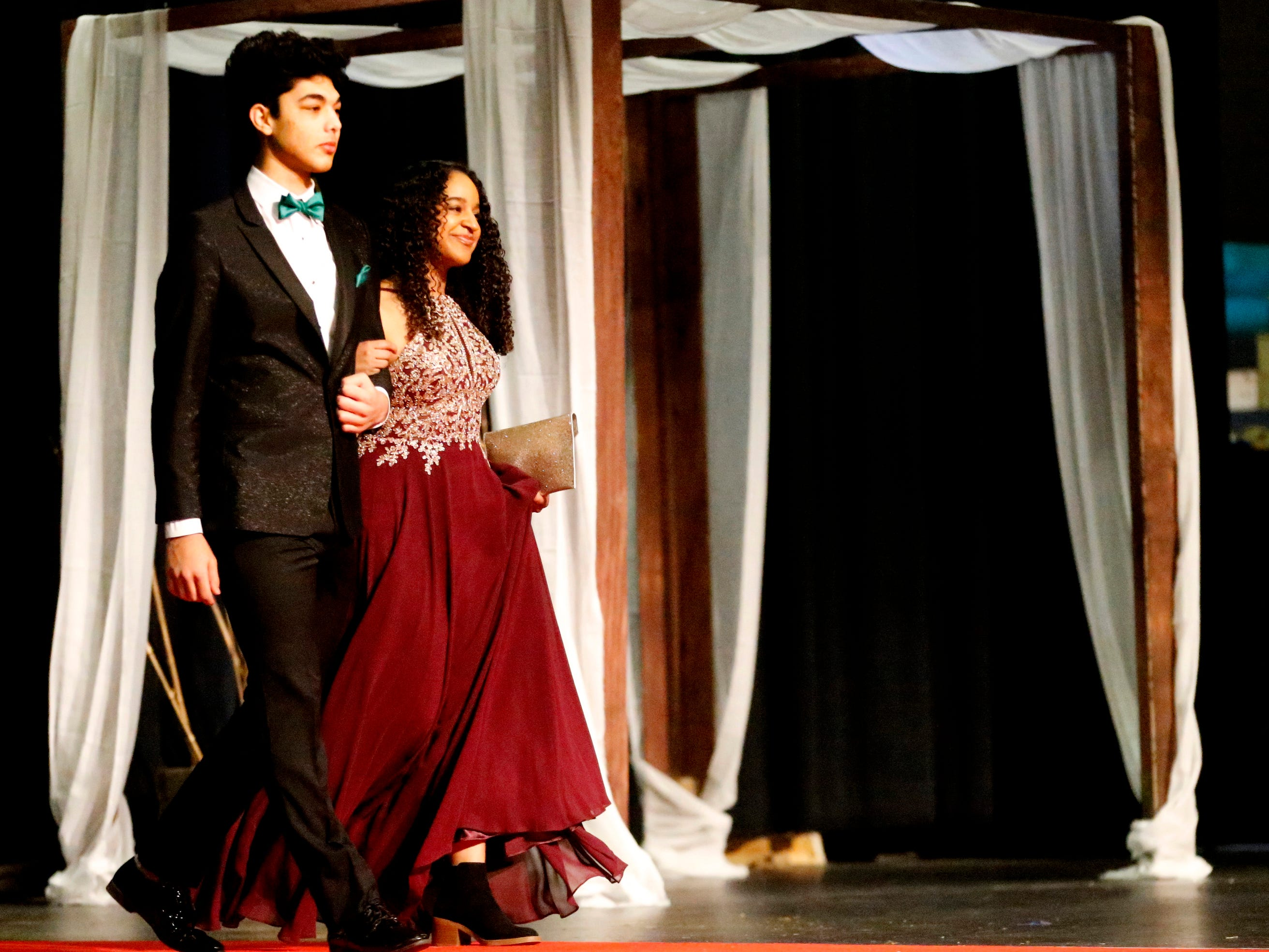 Hussain Alzubaridi, left and Nicole Clarke show off the latest in prom fashions during the Siegel Prom Fashion show on Thursday, Feb. 14, 2019.