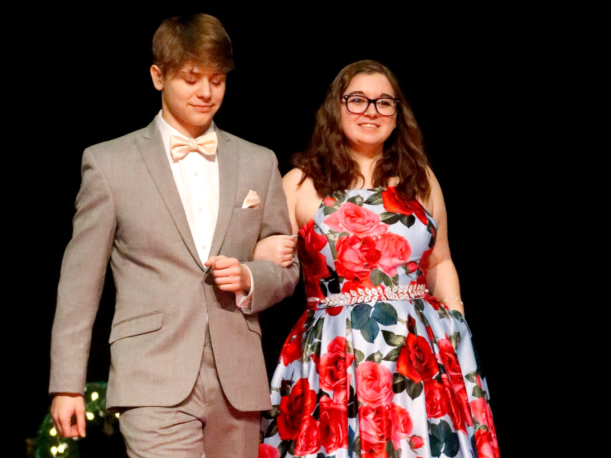 Shane Wozniak, left and Mackenzie Lee, right show off the latest in prom fashions during the Siegel Prom Fashion show on Thursday, Feb. 14, 2019.