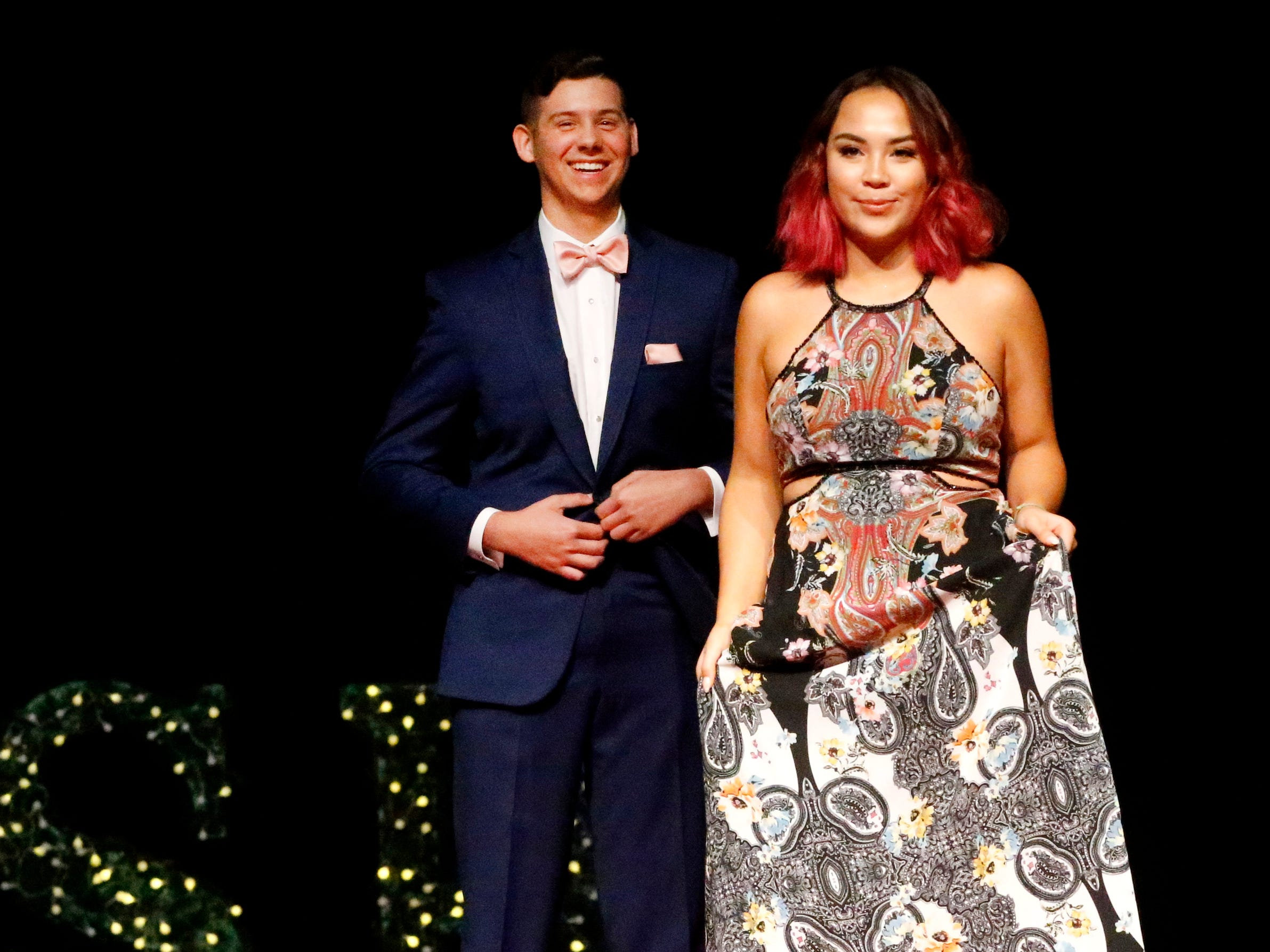 Jeffery Young, left and Zoe Houghton, right show off the latest in prom fashions during the Siegel Prom Fashion show on Thursday, Feb. 14, 2019.