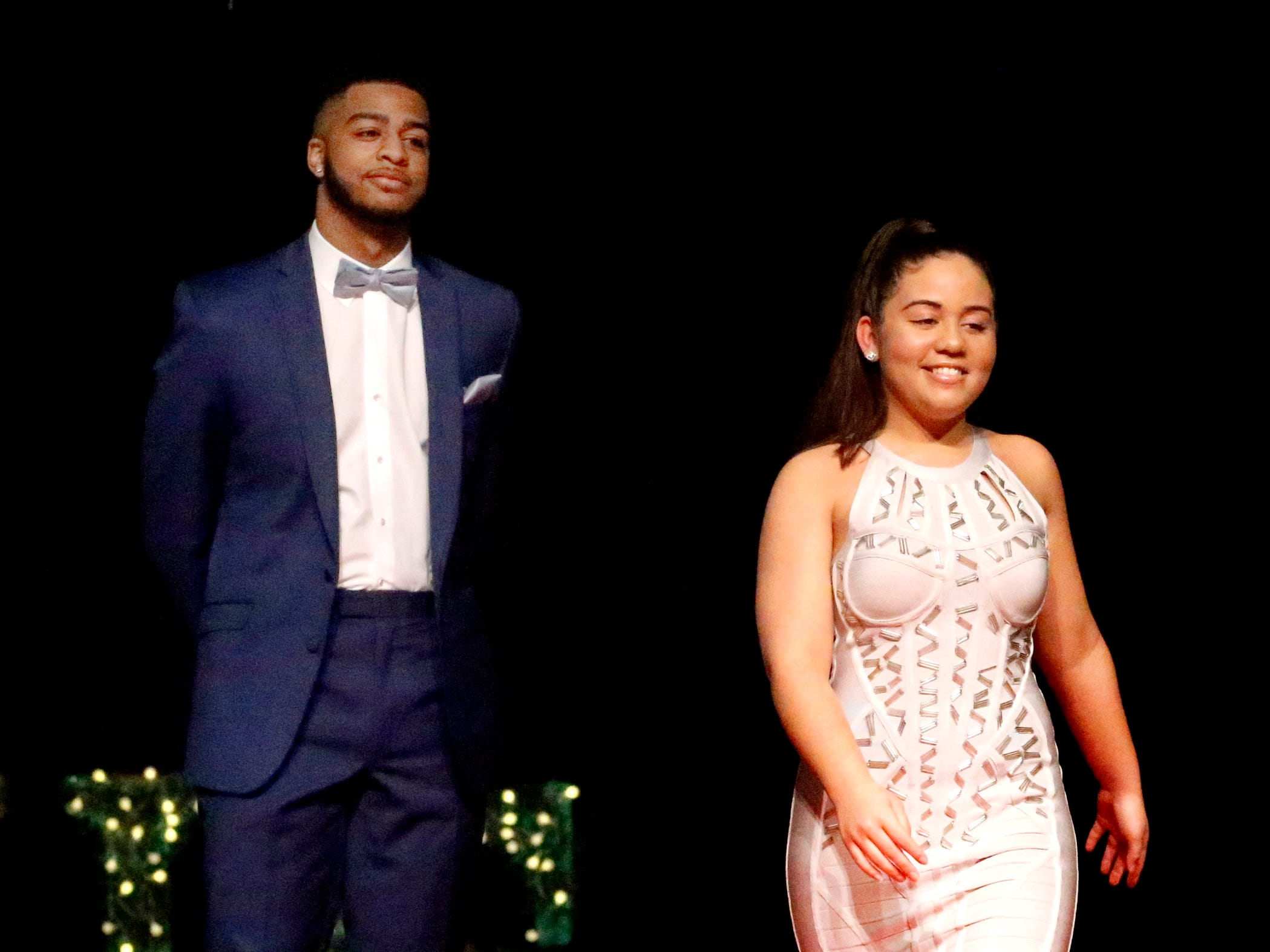 Joseph Howard, left and Sierra Cruz, right show off the latest in prom fashions during the Siegel Prom Fashion show on Thursday, Feb. 14, 2019.