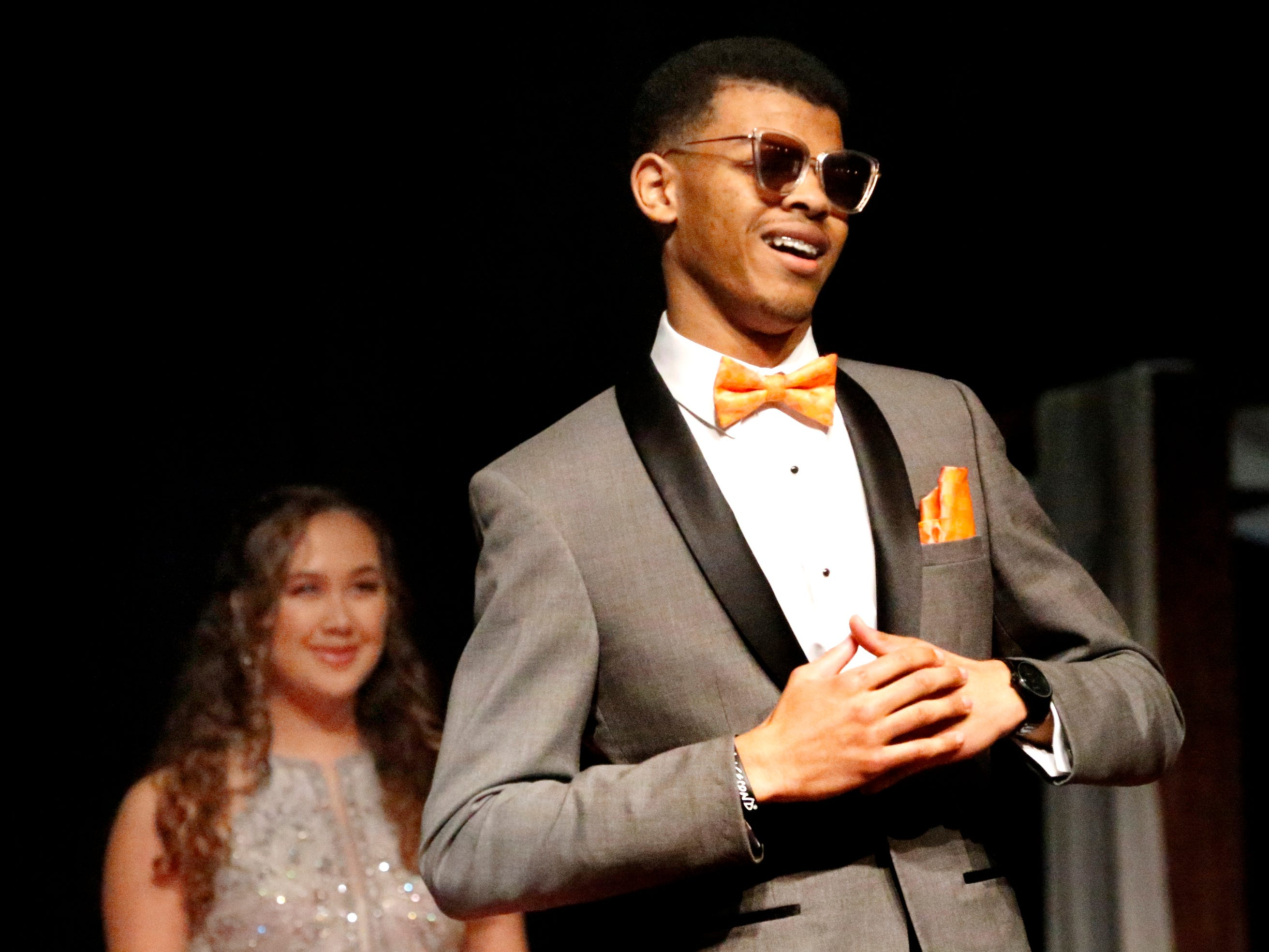 Jaylen Avant shows off his tux at the end of the runway during the Siegel Prom Fashion show on Thursday, Feb. 14, 2019.