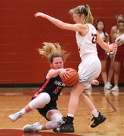 Oakland's Claira McGowan (11) falls down with the ball as she runs into Riverdale's Jalyn Holcomb (23) during the Region 4-AAA Championship game on Wednesday, Feb. 27, 2019.