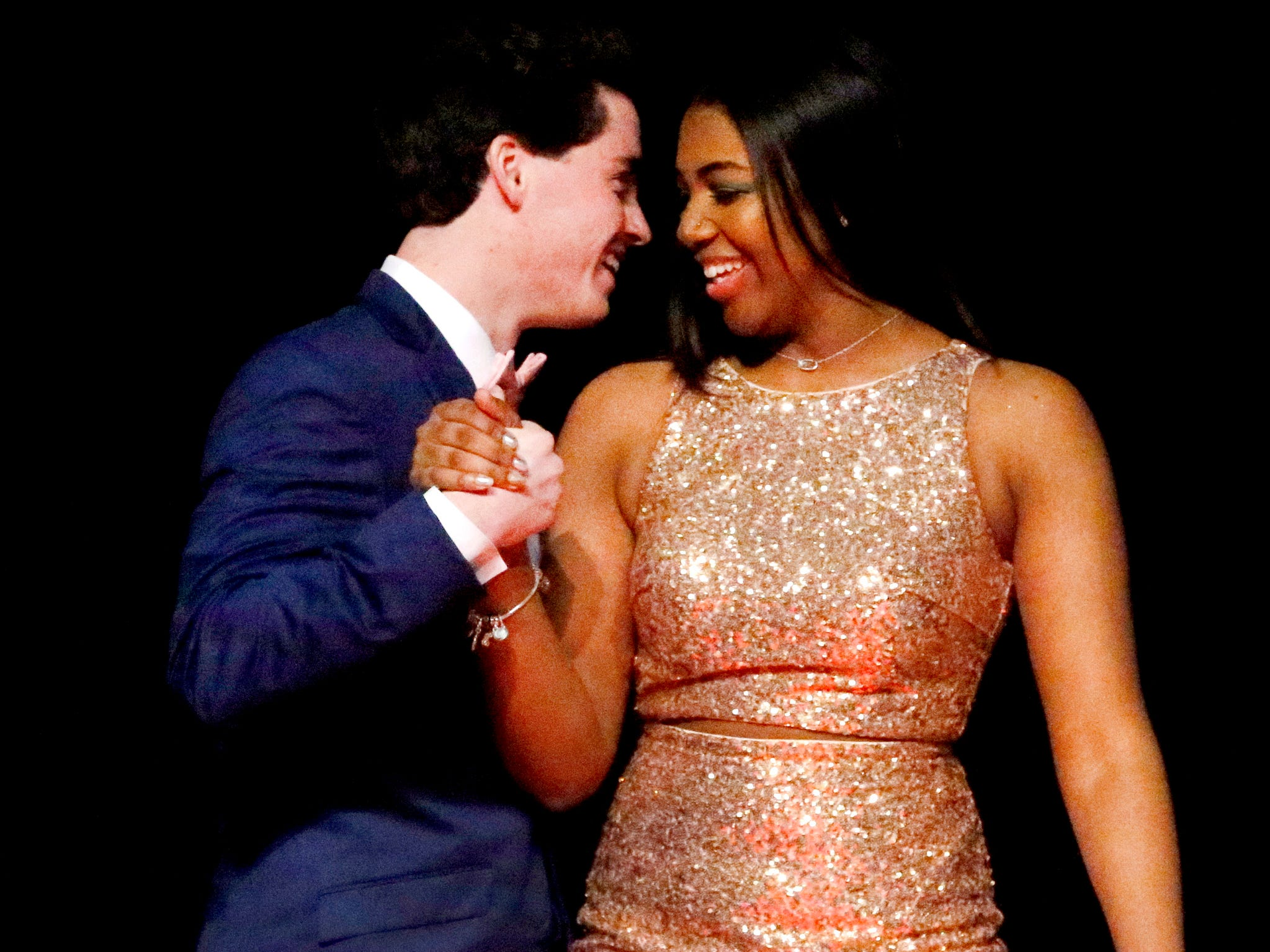 Cooper Moss, left and Iylana Fisher, right show off the latest in prom fashions during the Siegel Prom Fashion show on Thursday, Feb. 14, 2019.