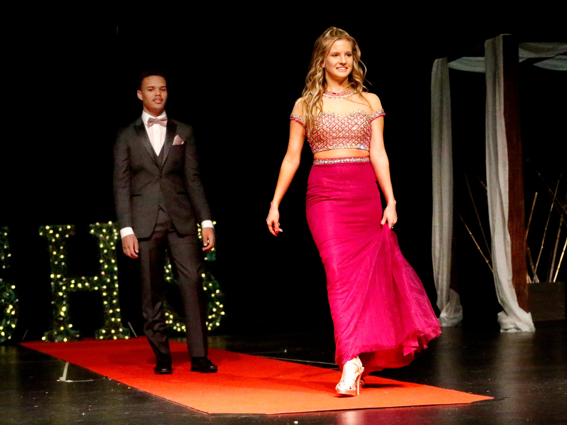 Sara Jarrell steps forward to show off her dress as Cory Cury waits to show off his tux during the Siegel Prom Fashion show on Thursday, Feb. 14, 2019.