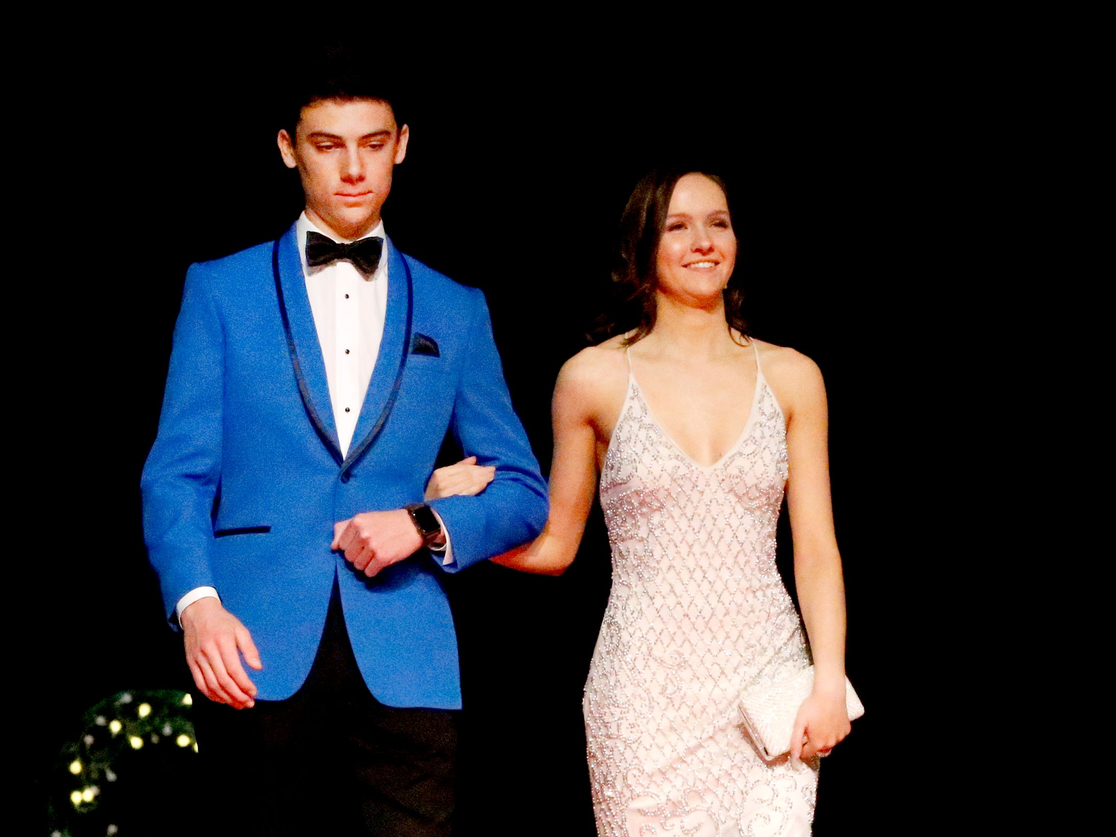 Adam Lalance, left and Lucy Bridges, right show off the latest in prom fashions during the Siegel Prom Fashion show on Thursday, Feb. 14, 2019.