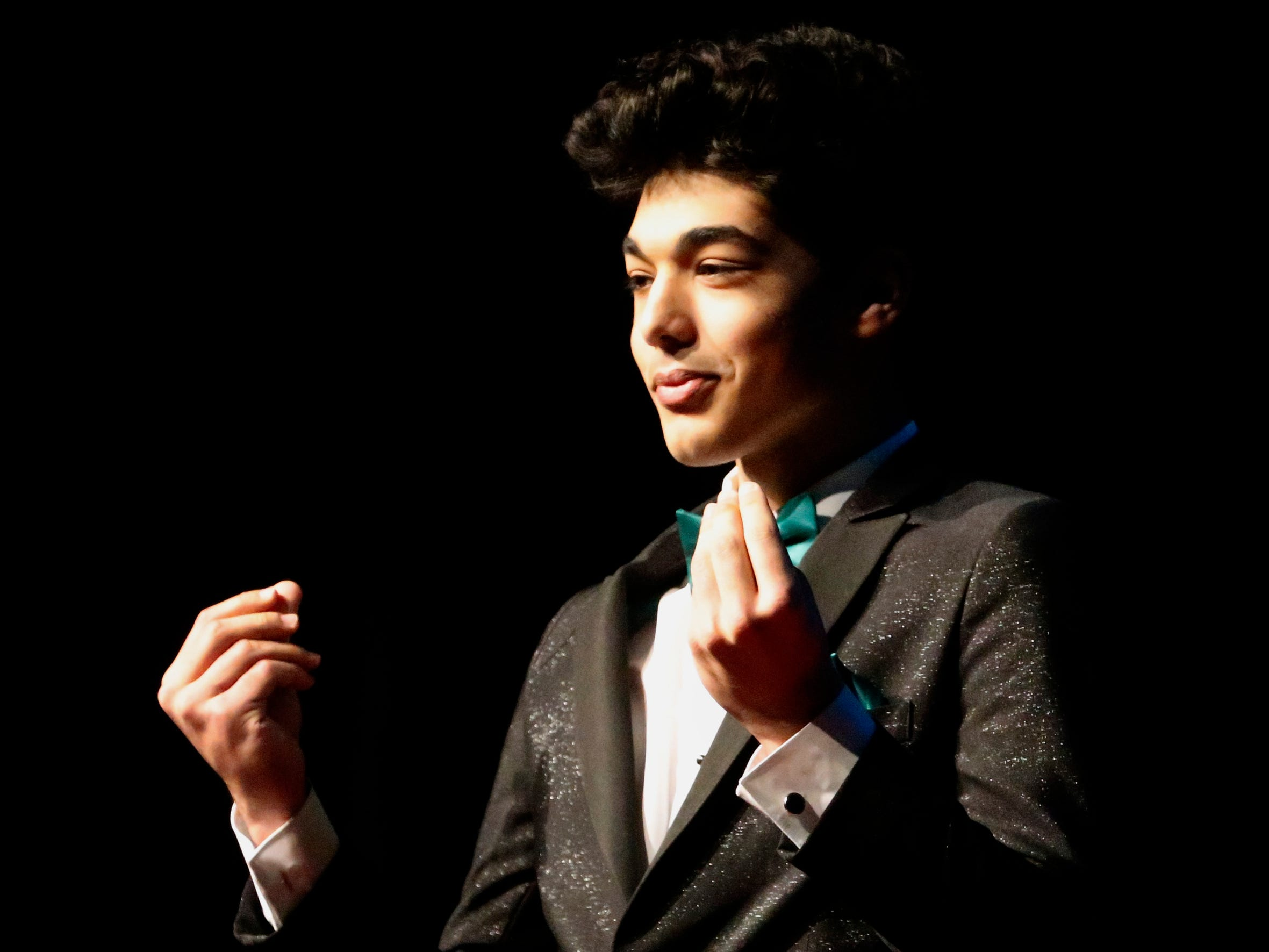 Hussain Alzubaidi shows off his tux at the end of the runway during the Siegel Prom Fashion show on Thursday, Feb. 14, 2019.