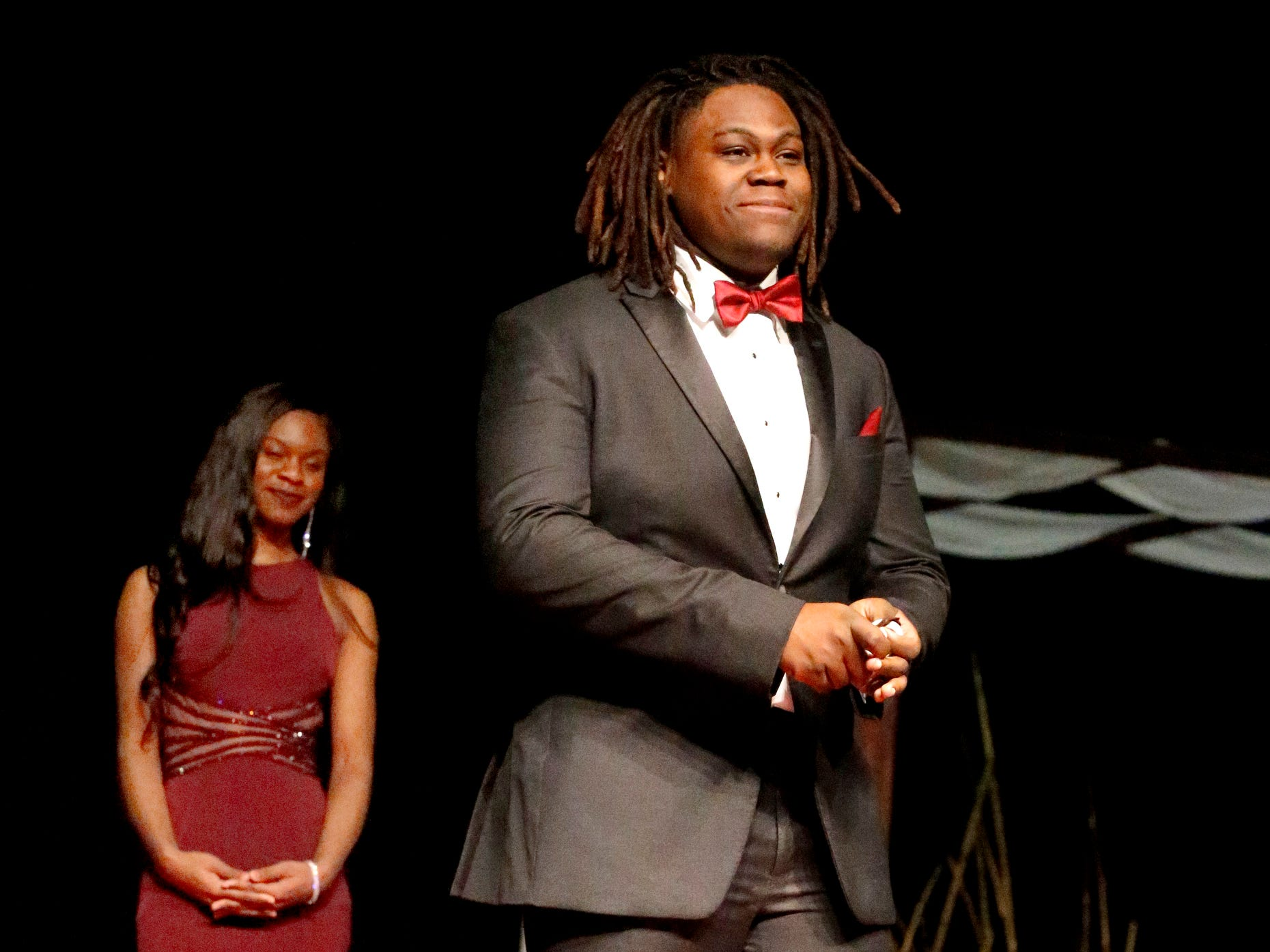 Khalil Wilson steps forward to show off his tux after Kimia Wade modeled her dress during the Siegel Prom Fashion show on Thursday, Feb. 14, 2019.