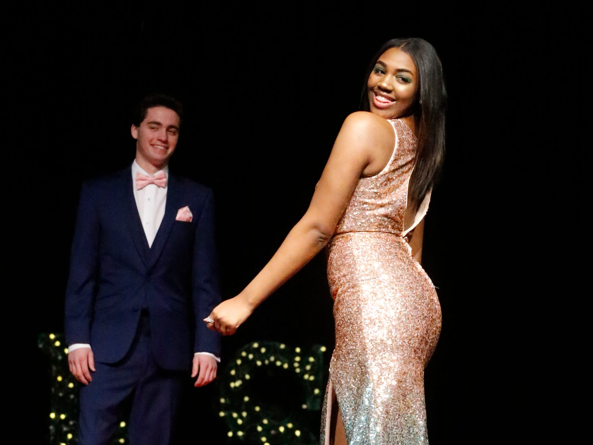 Iylana Fisher steps forward to show off her dress as Cooper Moss waits to show off his tux during the Siegel Prom Fashion show on Thursday, Feb. 14, 2019.