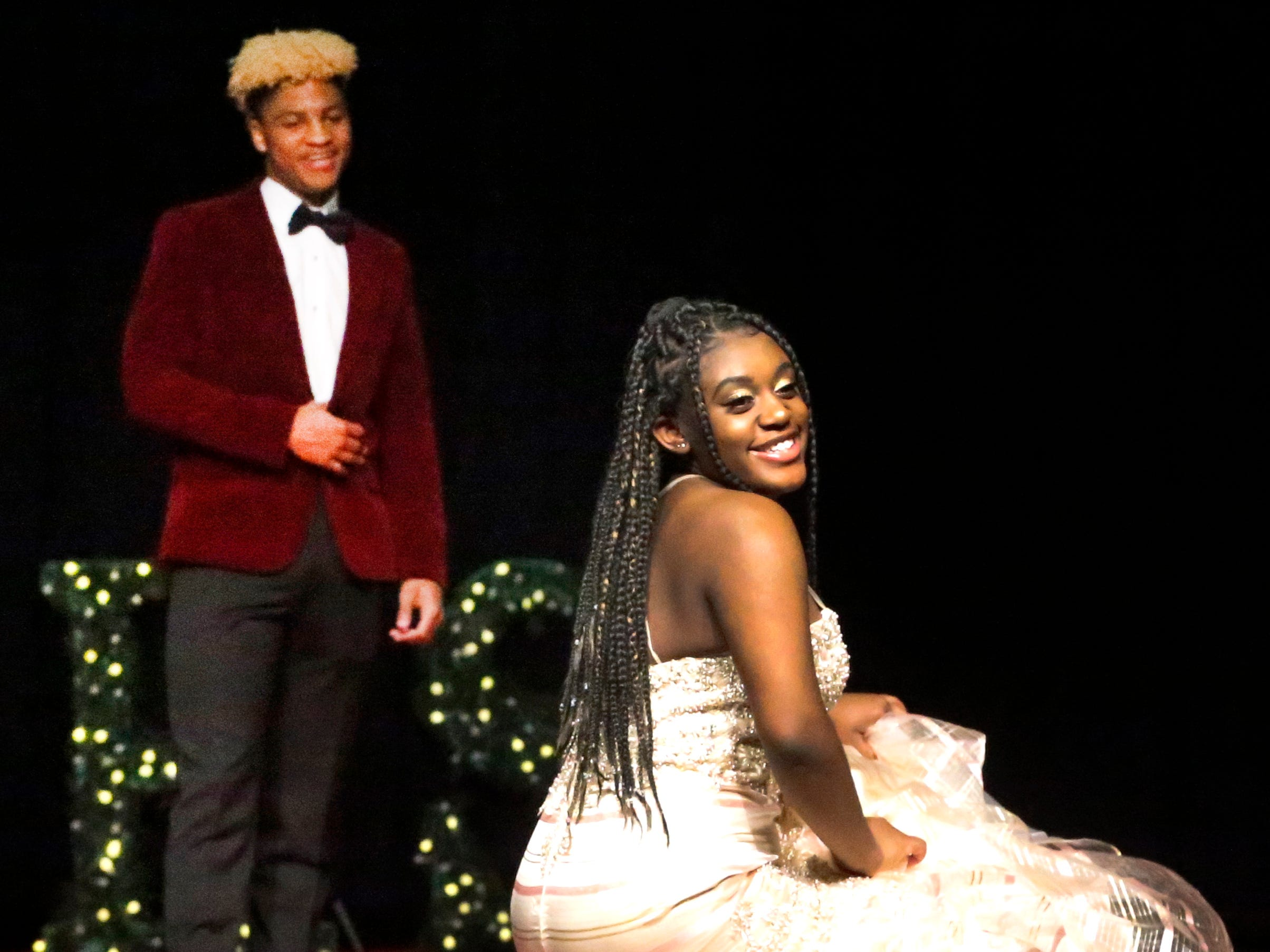 Ami Brewster steps forward to show off her dress asRyan Wilson waits to show off his tux during the Siegel Prom Fashion show on Thursday, Feb. 14, 2019.