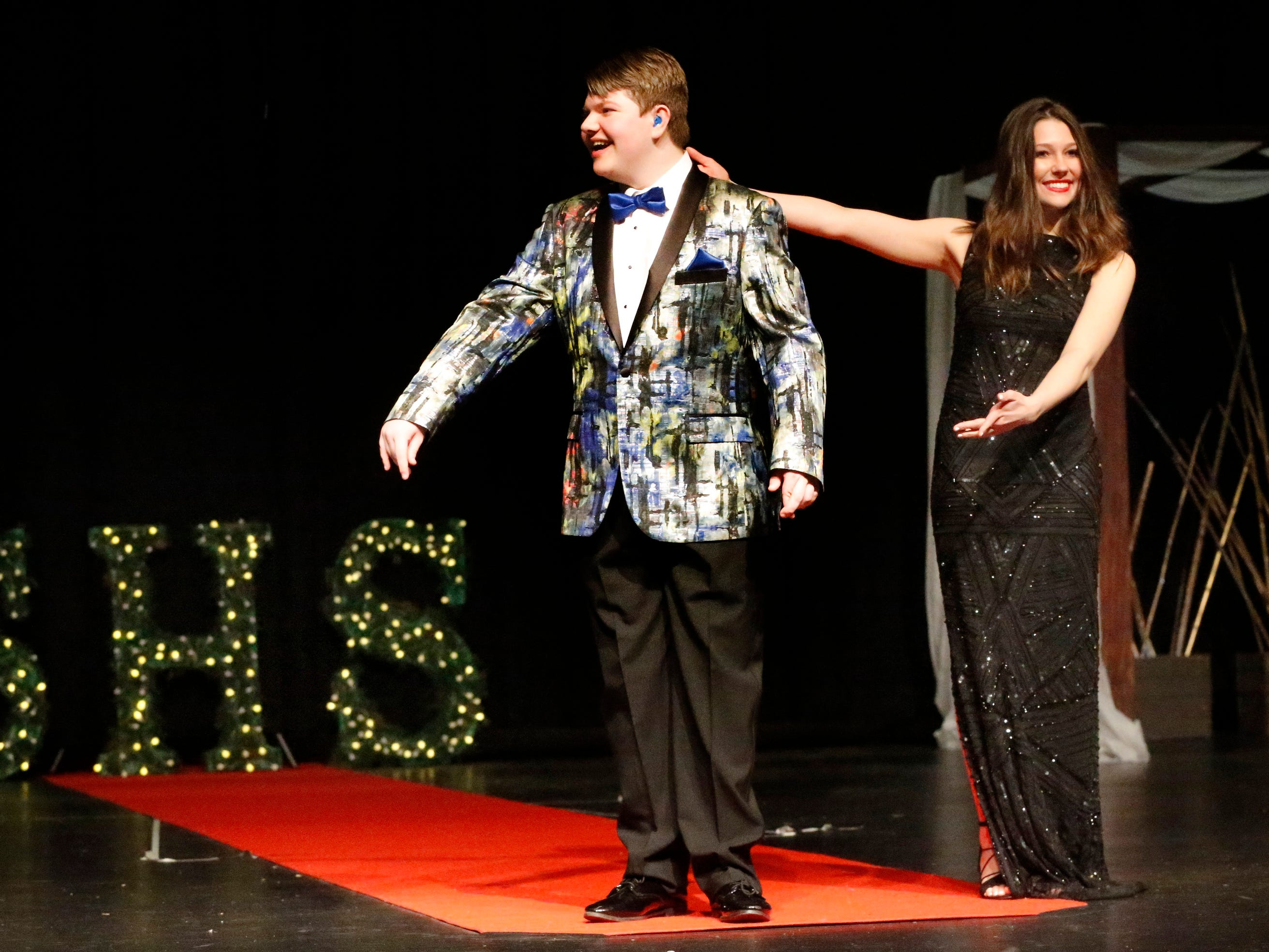 Tyler Persinger, left, and Jordan Black show off the latest in prom fashions during the Siegel Prom Fashion Show on Feb. 14, 2019.