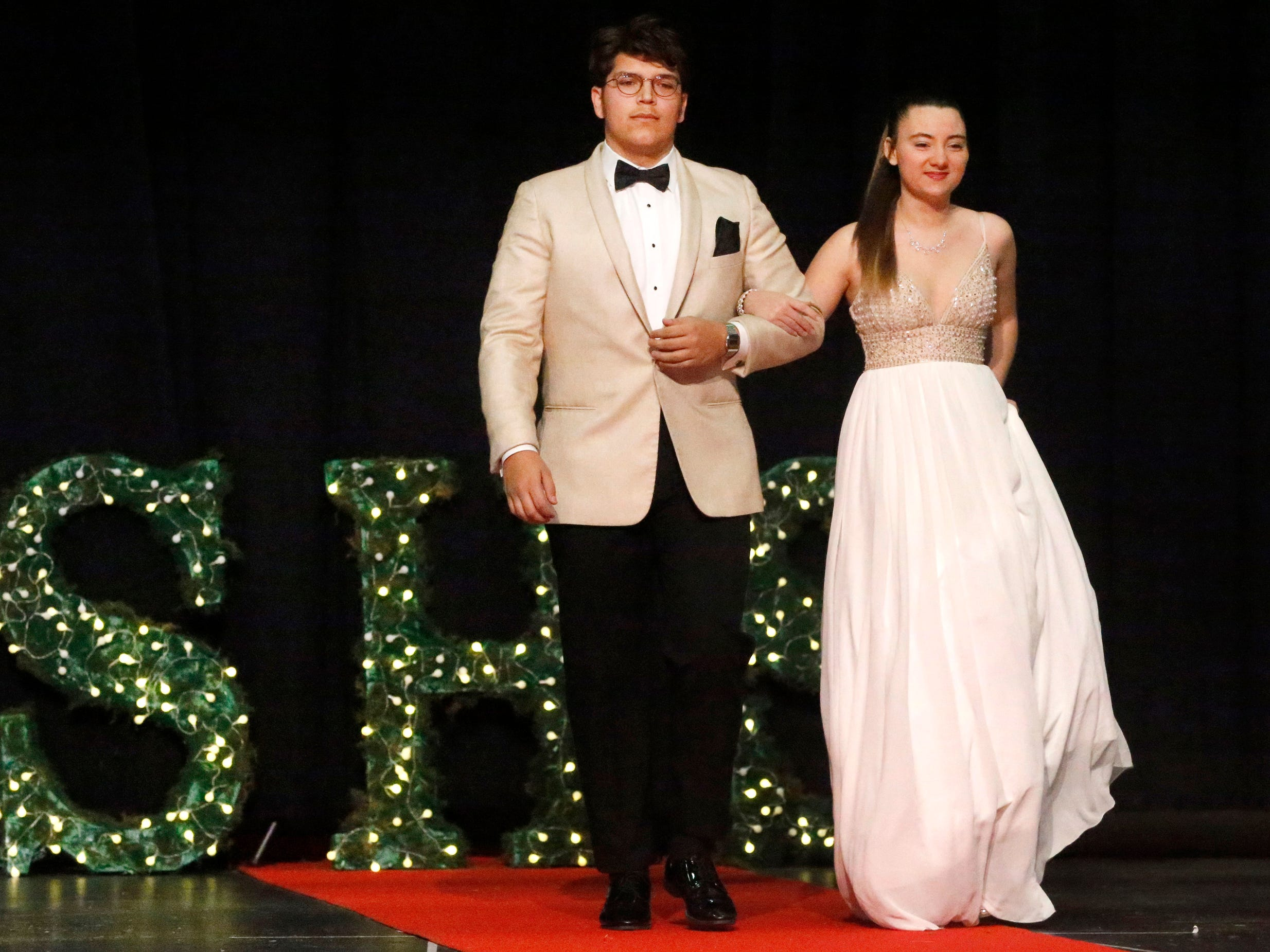 Marc Padilla, left andAubrie Shanks, right show off the latest in prom fashions during the Siegel Prom Fashion show on Thursday, Feb. 14, 2019.