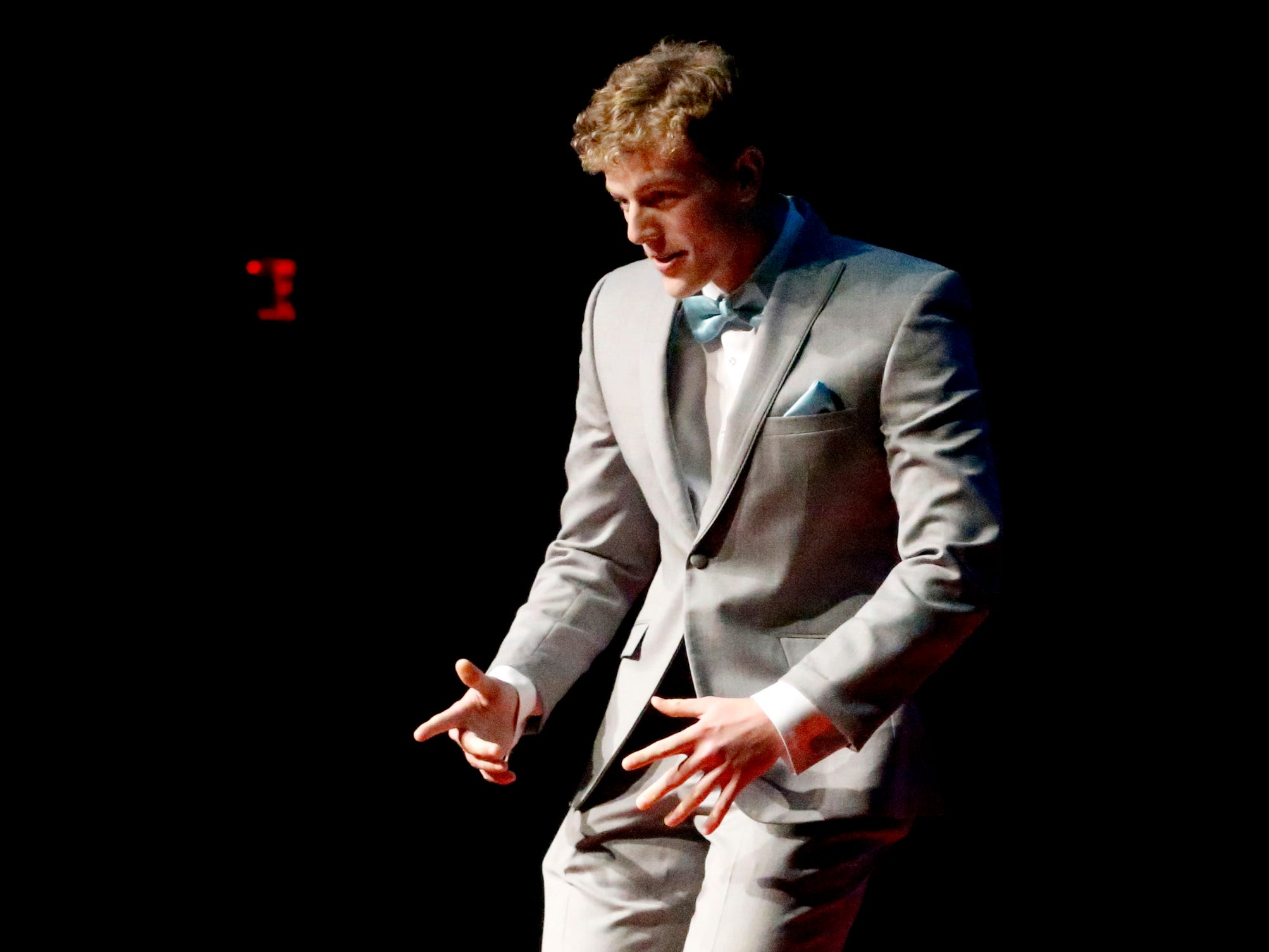 Patrick Moss dances at the end of the runway as he participates in the Siegel Prom Fashion show on Thursday, Feb. 14, 2019.