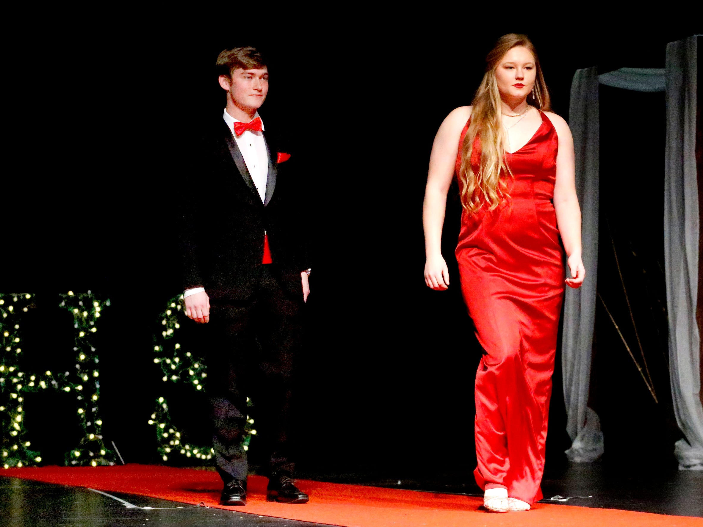 Jackson Jordan, left and Hannah Milhorn, right show off the latest in prom fashions during the Siegel Prom Fashion show on Thursday, Feb. 14, 2019.