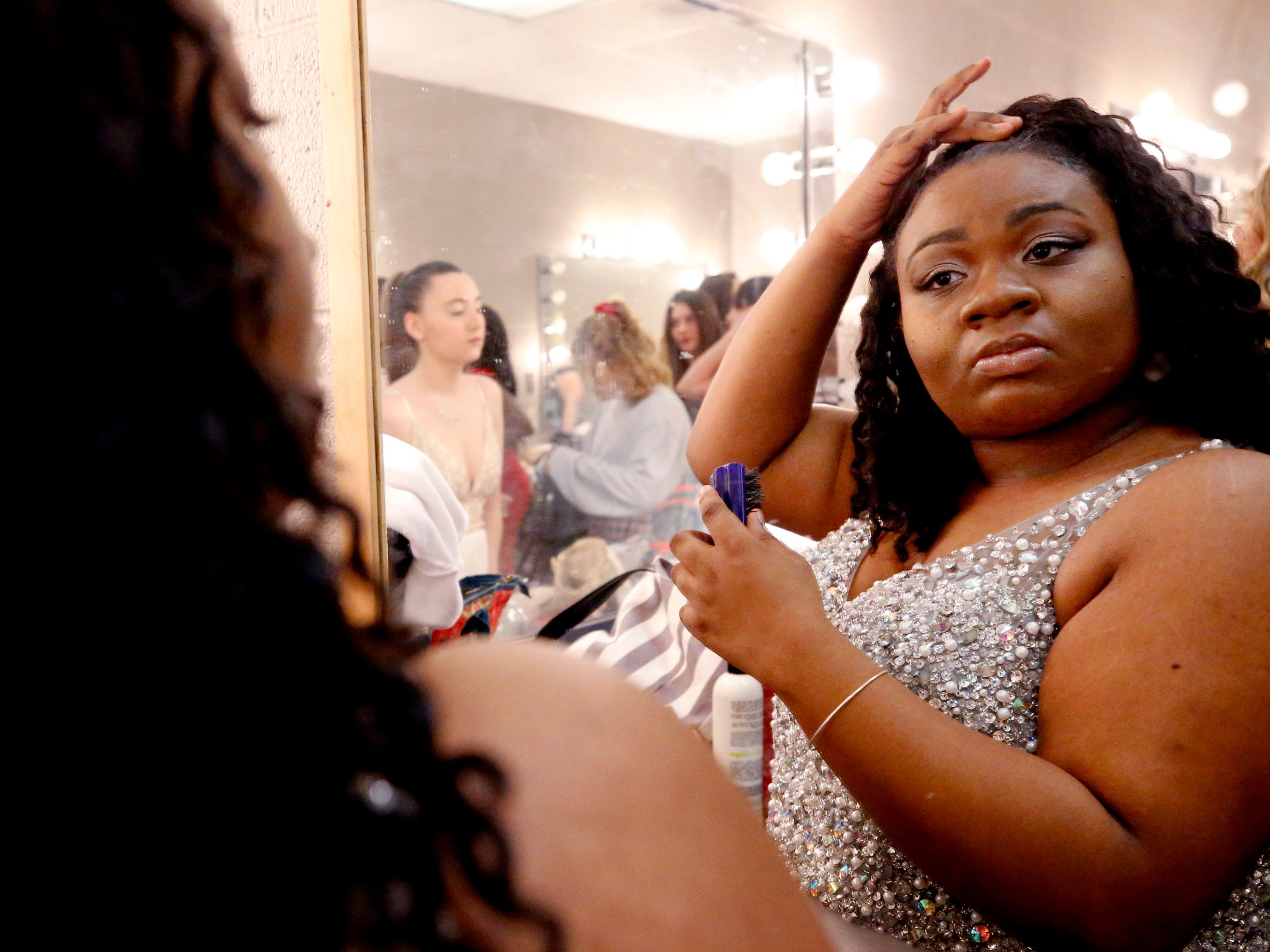 Shakayla Davis gets ready for the Siegel Prom Fashion show on Thursday, Feb. 14, 2019.