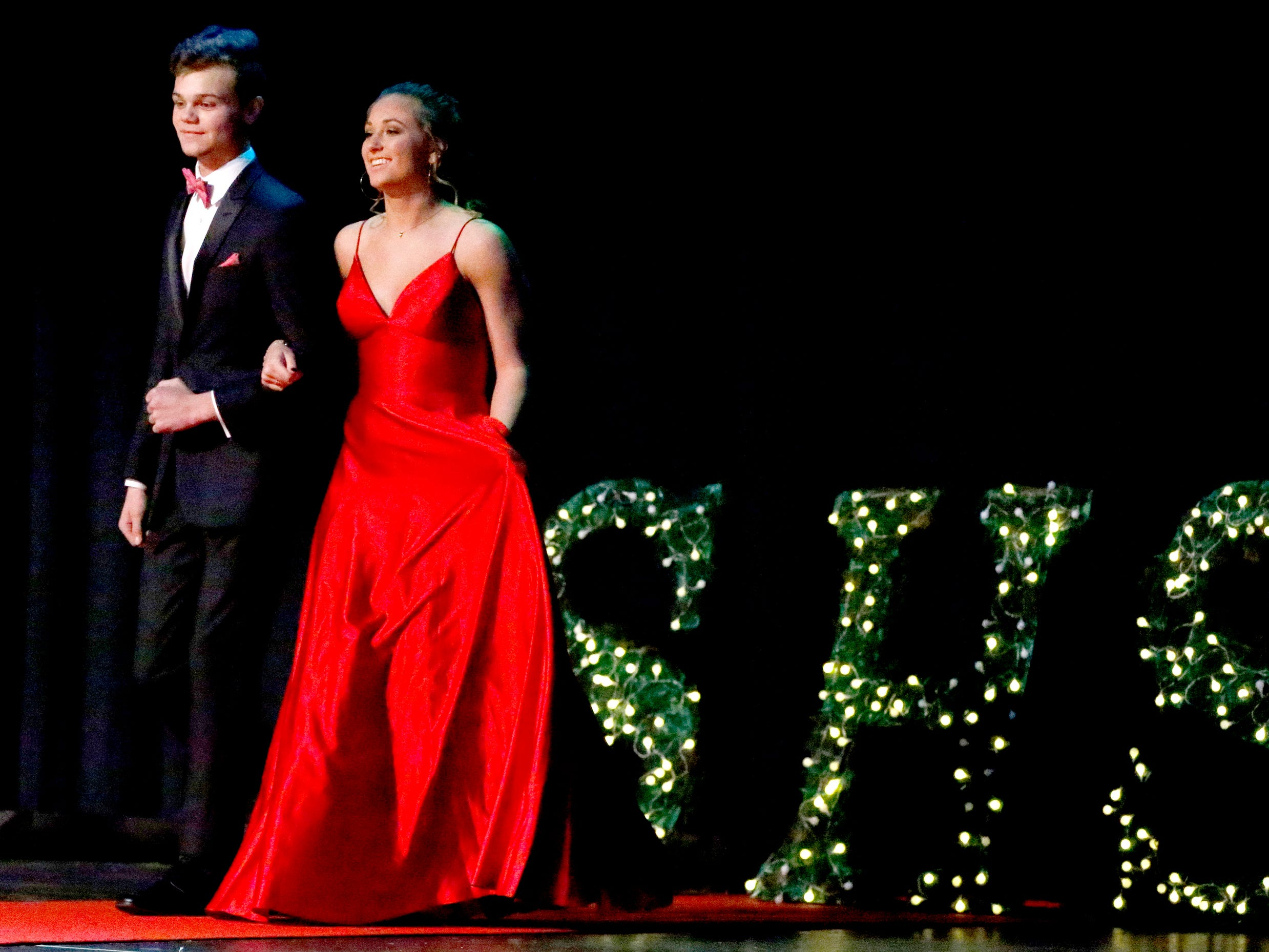 Collin Mathis, left and Julia Wheeler, right show off the latest in prom fashions during the Siegel Prom Fashion show on Thursday, Feb. 14, 2019.