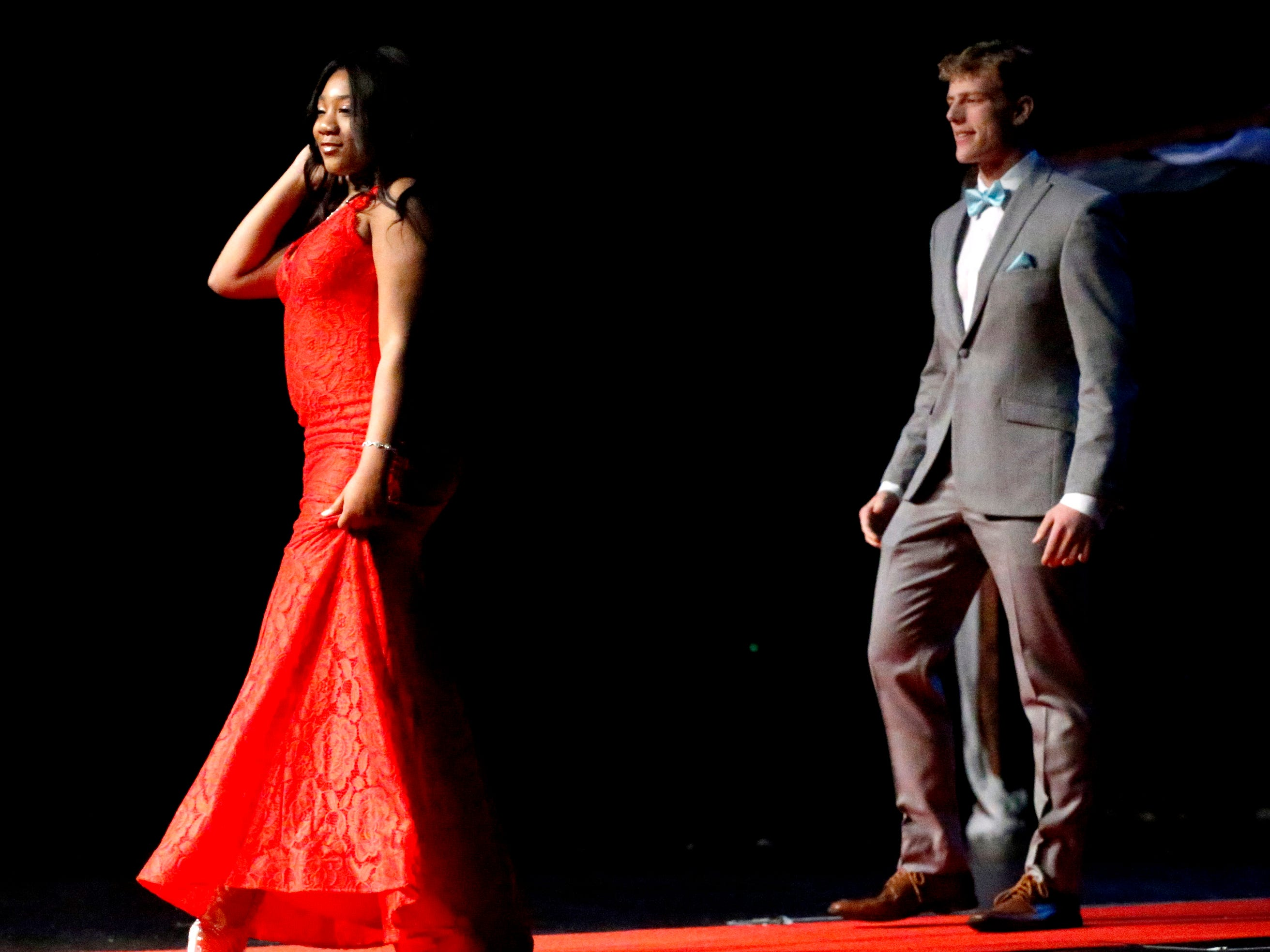 Kayla Daniels, left and Patrick Moss, right show off the latest in prom fashions during the Siegel Prom Fashion show on Thursday, Feb. 14, 2019.