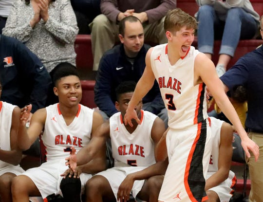 Blackman's Jordan Burchfield (3) celebrates as he comes out of the game late in the fourth quarter during the Region 4-AAA Semifinal game against Siegel, on Wednesday, Feb. 27, 2019.