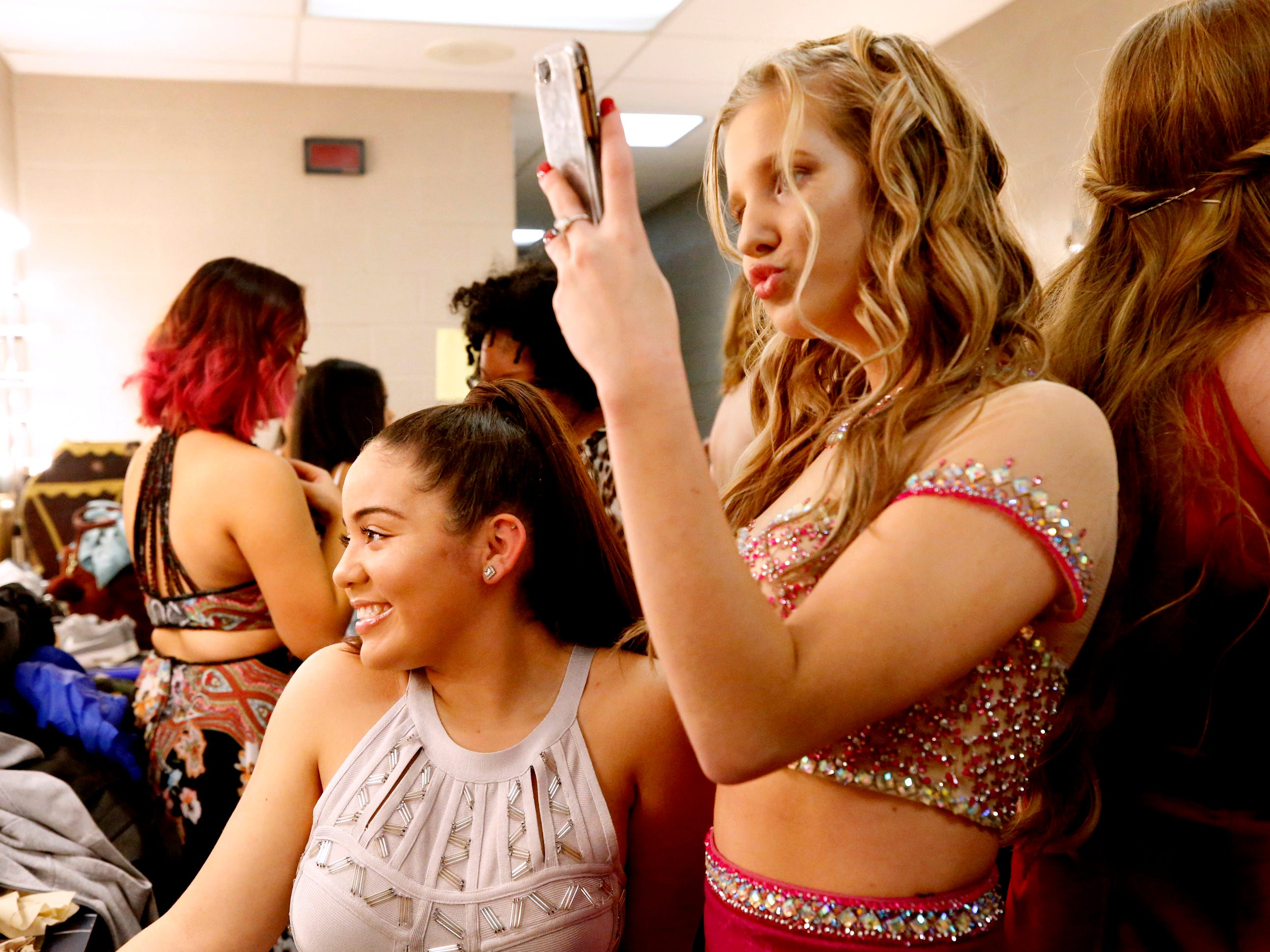 Sierra Cruz, left and Sara Jarrell take a selfie together backstage before the Siegel Prom Fashion show on Thursday, Feb. 14, 2019.