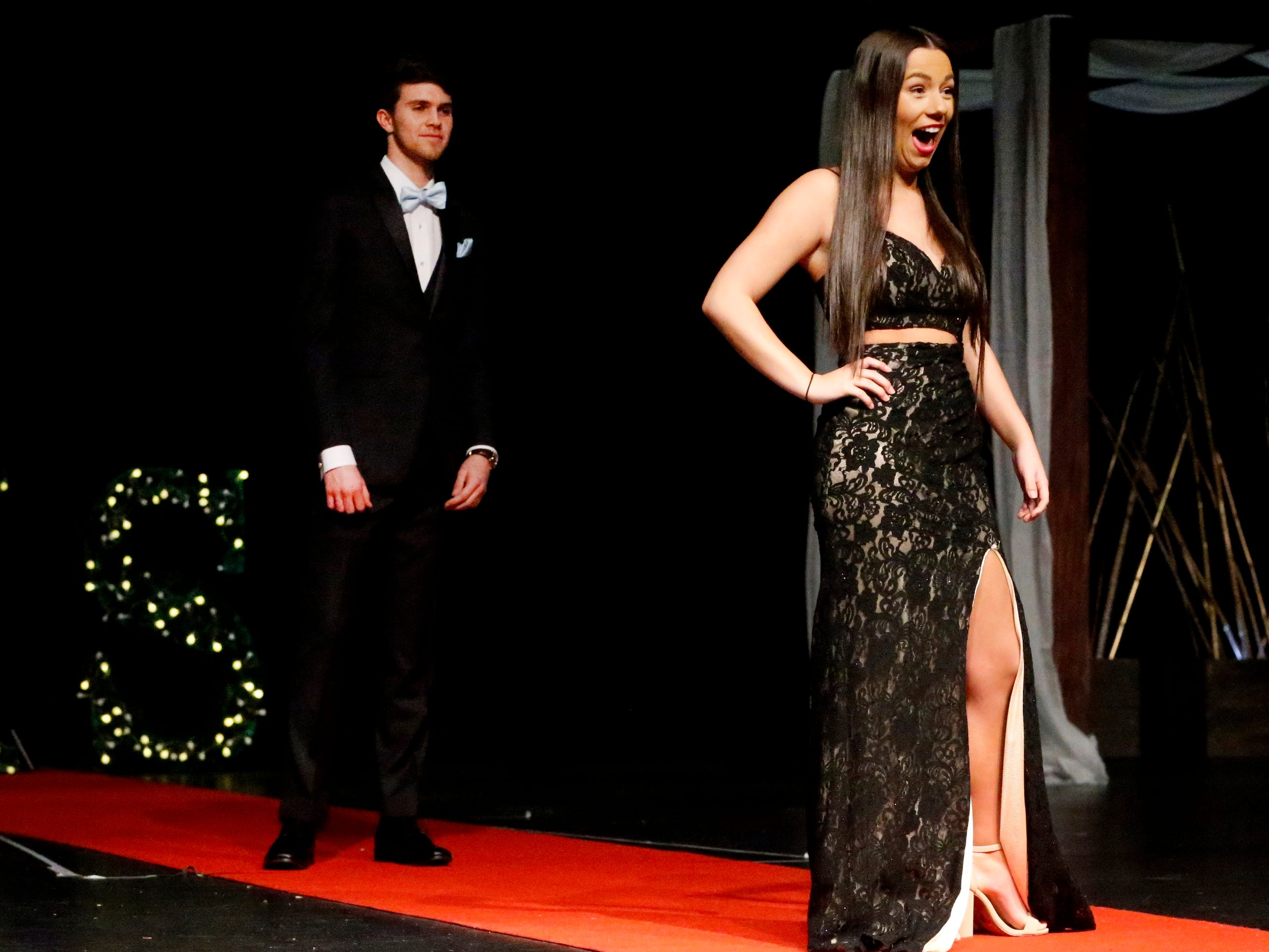 Whitney Tallant steps forward to show off her dress as Connor Beckham waits to show off his tux during the Siegel Prom Fashion show on Thursday, Feb. 14, 2019.