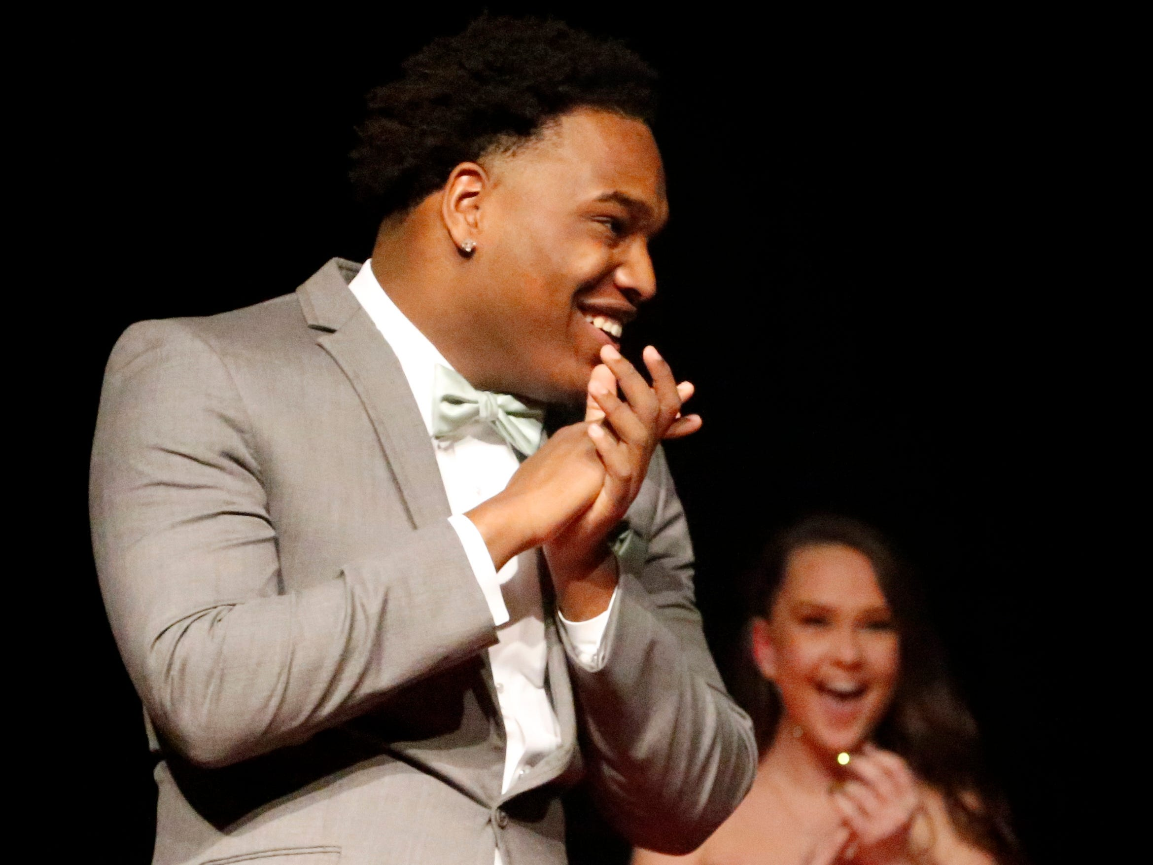 Shamar Vanzant shows off his tux at the end of the runway during the Siegel Prom Fashion show on Thursday, Feb. 14, 2019.