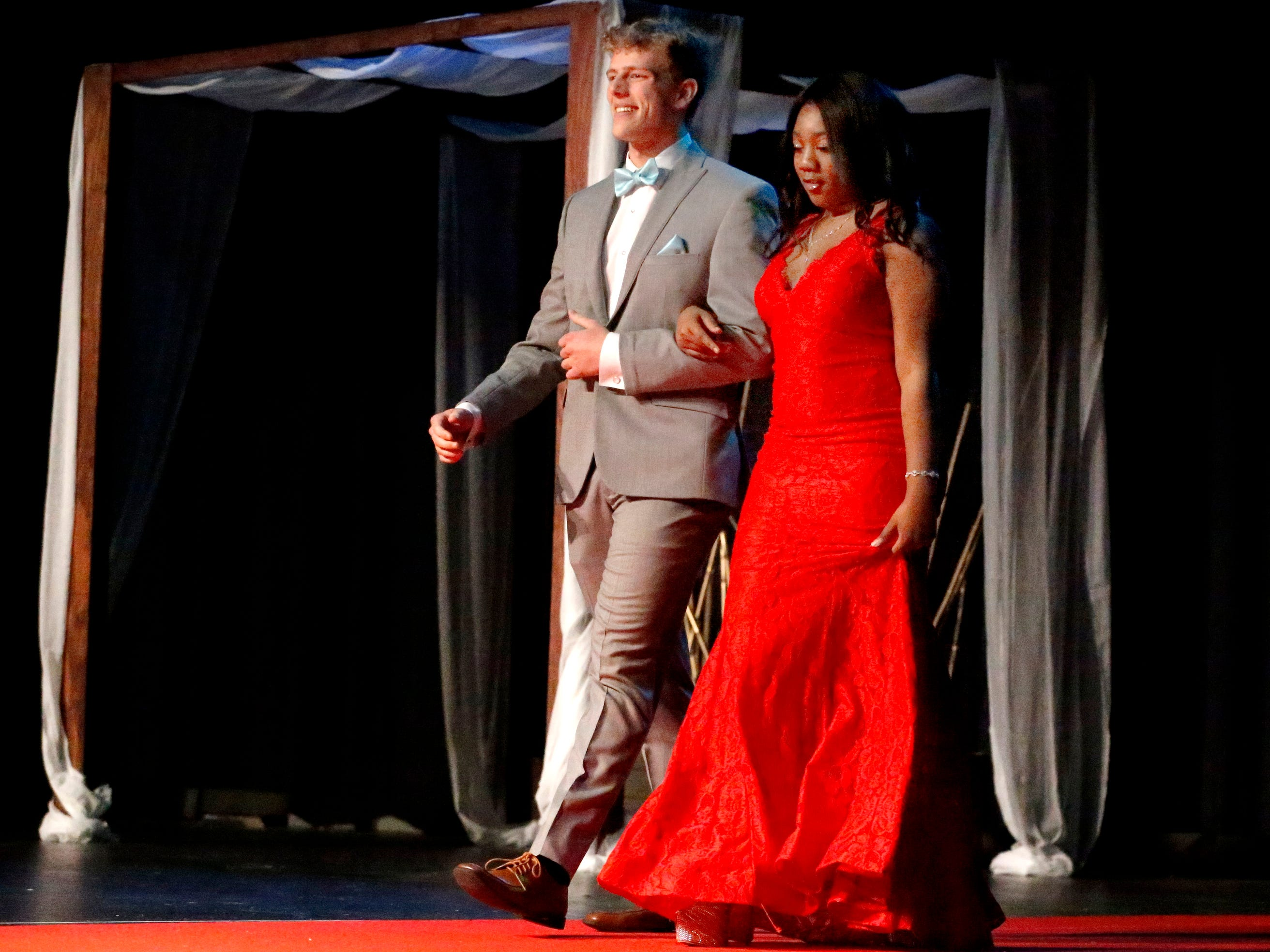 Patrick Moss, left and Kayla Daniels, right show off the latest in prom fashions during the Siegel Prom Fashion show on Thursday, Feb. 14, 2019.