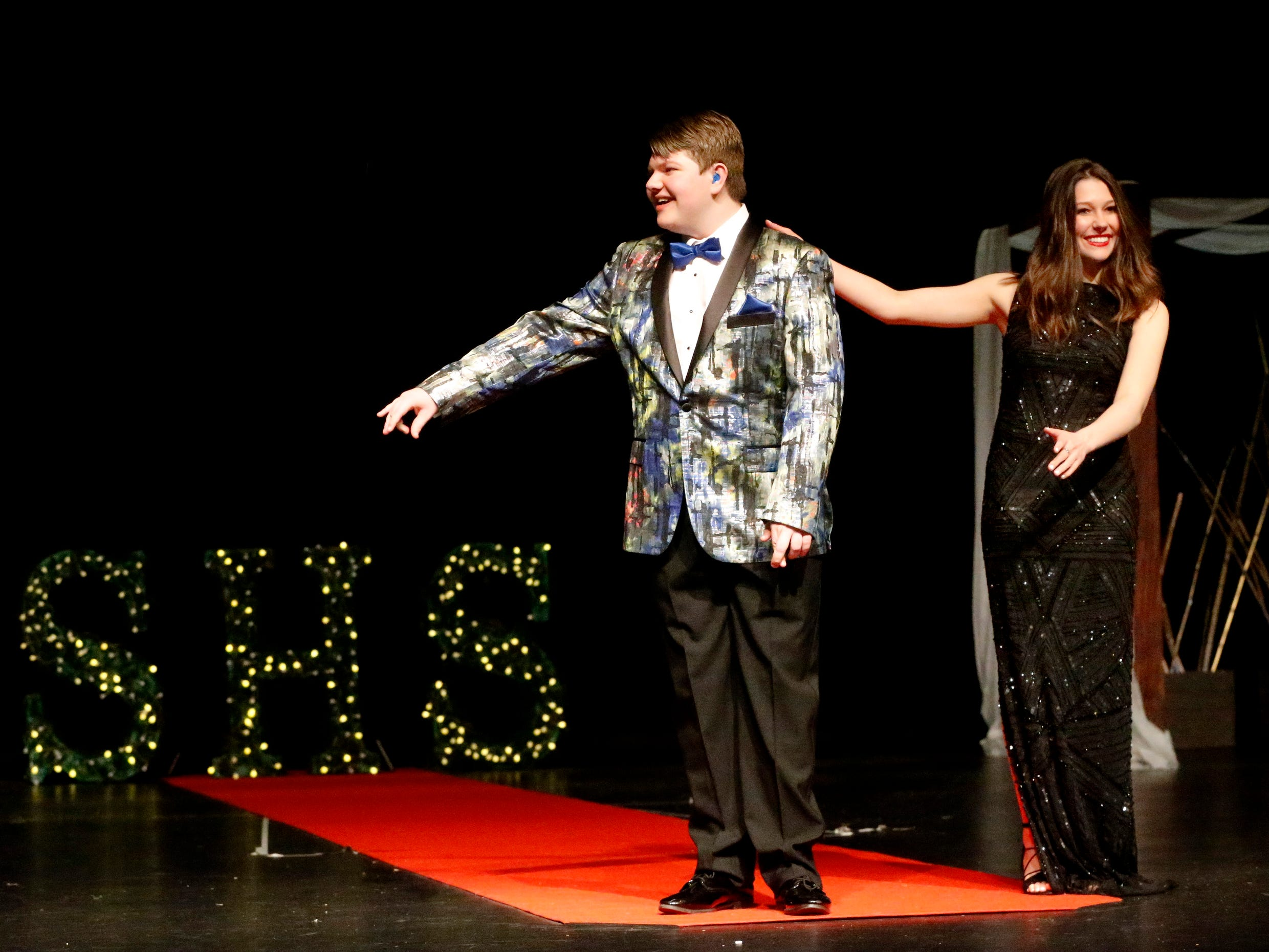Tyler Persinger, left and Jordan Black, right show off the latest in prom fashions during the Siegel Prom Fashion show on Thursday, Feb. 14, 2019.