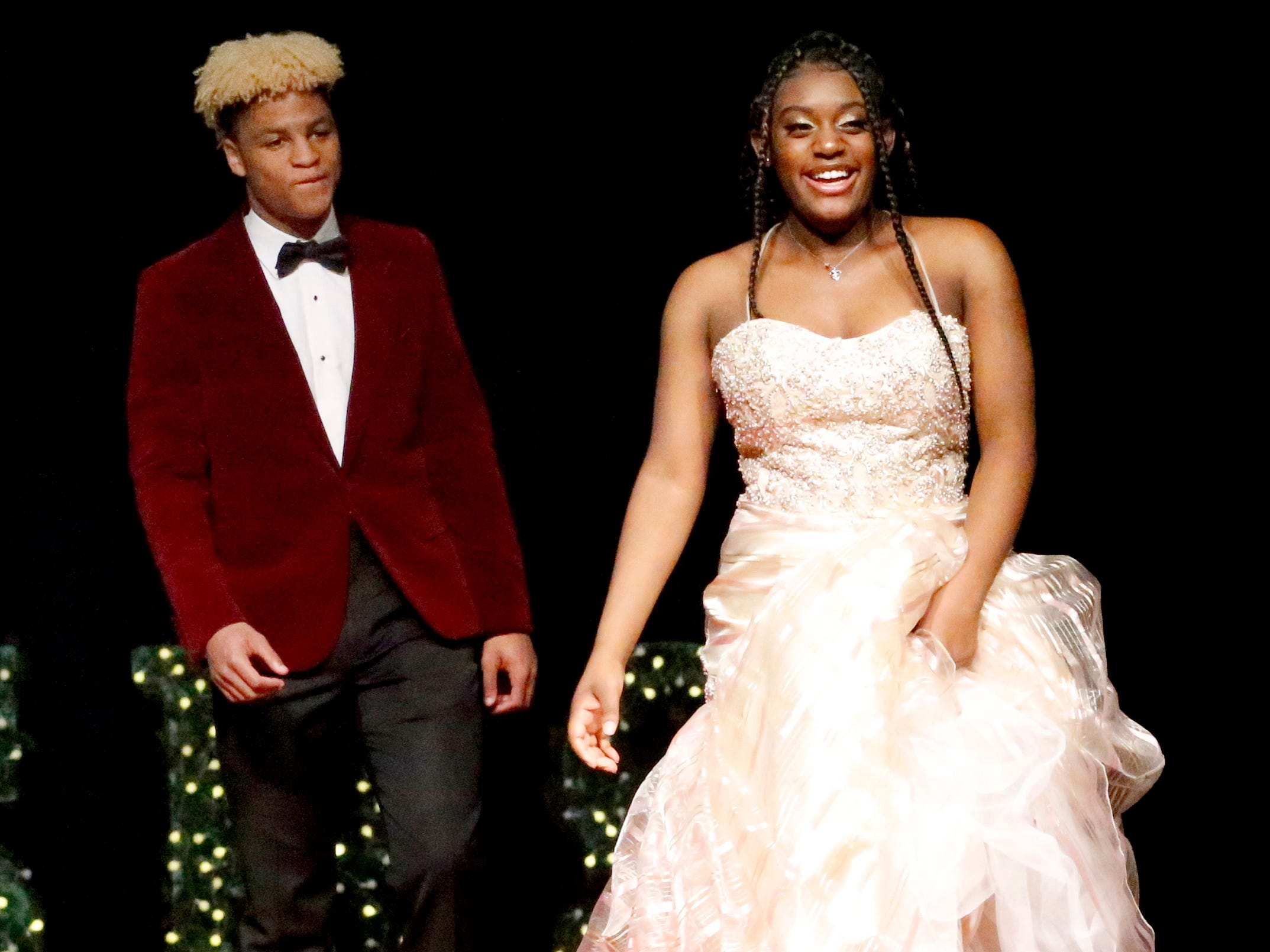 Ryan Wilson, left and Amia Brewster, right show off the latest in prom fashions during the Siegel Prom Fashion show on Thursday, Feb. 14, 2019.