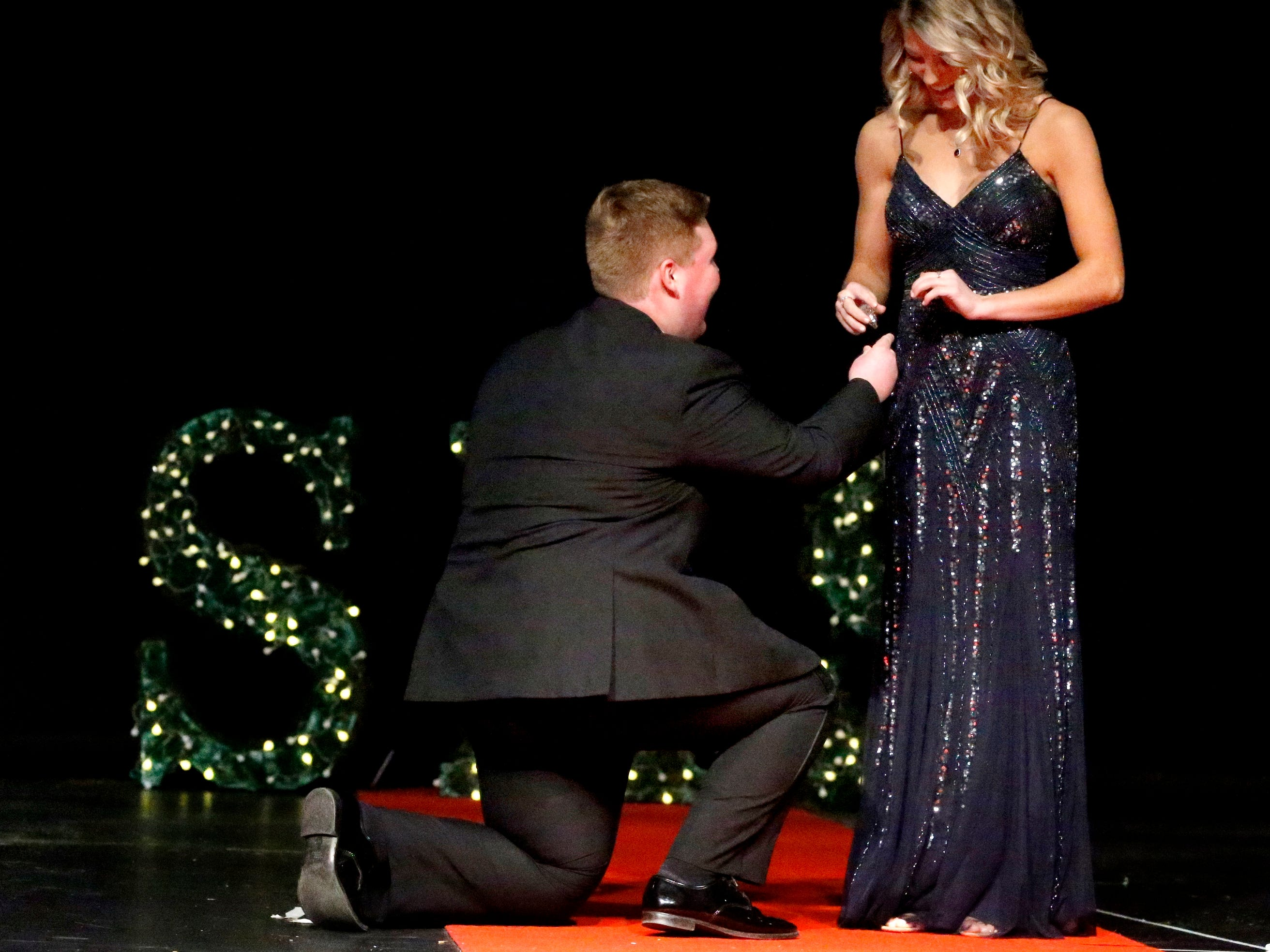Hunter Paschall, left pretends to present Presley Leebrick, right with an engagment ring during the Siegel Prom Fashion show on Thursday, Feb. 14, 2019.