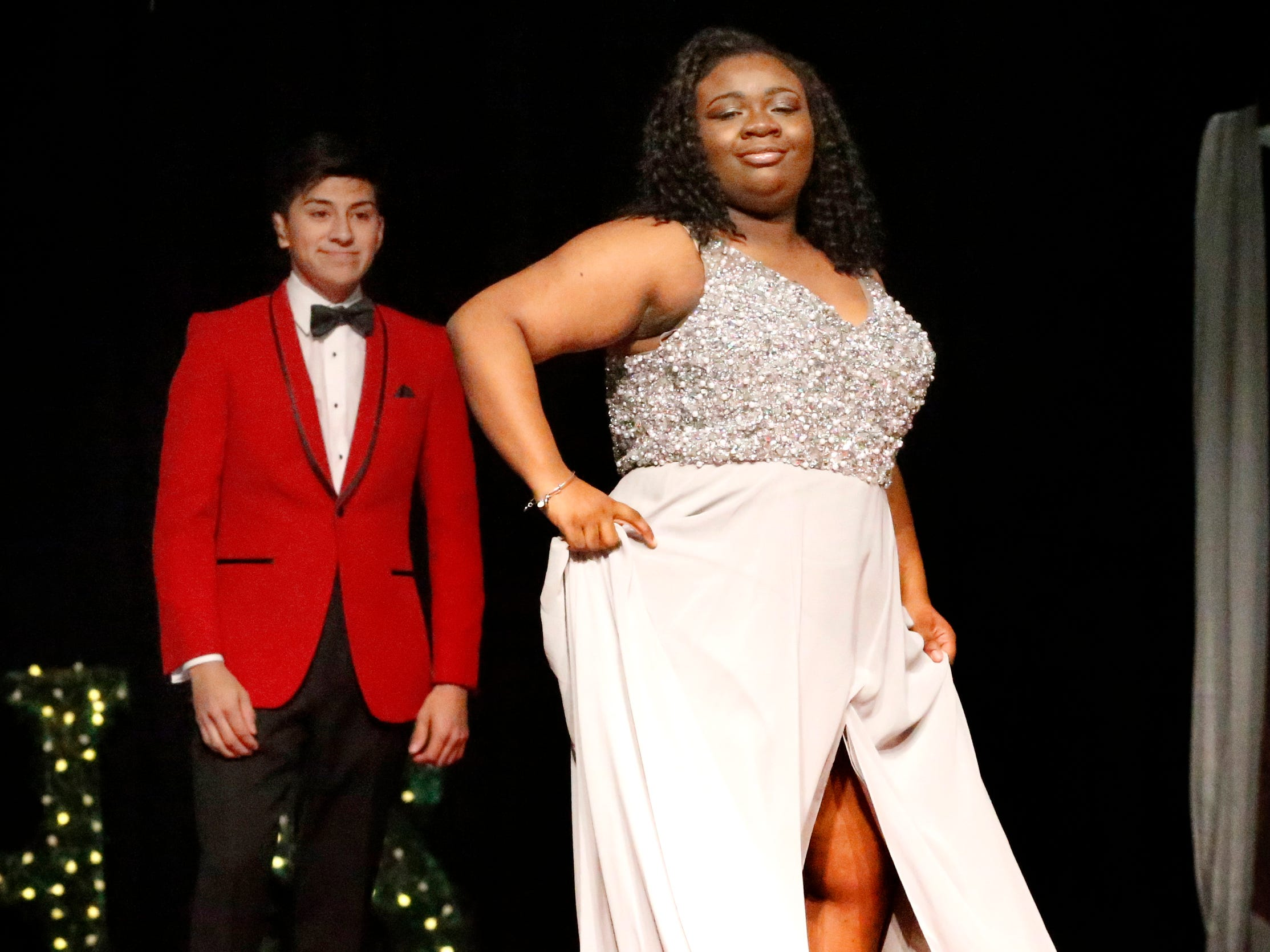 Shakayla Davis steps forward to show off her dress as Abraham Hernadez waits to show off his tux during the Siegel Prom Fashion show on Thursday, Feb. 14, 2019.