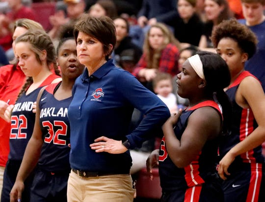 Oakland girls basketball coach Jennifer Grandstaff watches action during the Region 4-AAA championship game against Riverdale in February. Grandstaff stepped down as the Lady Patriots' coach Monday.