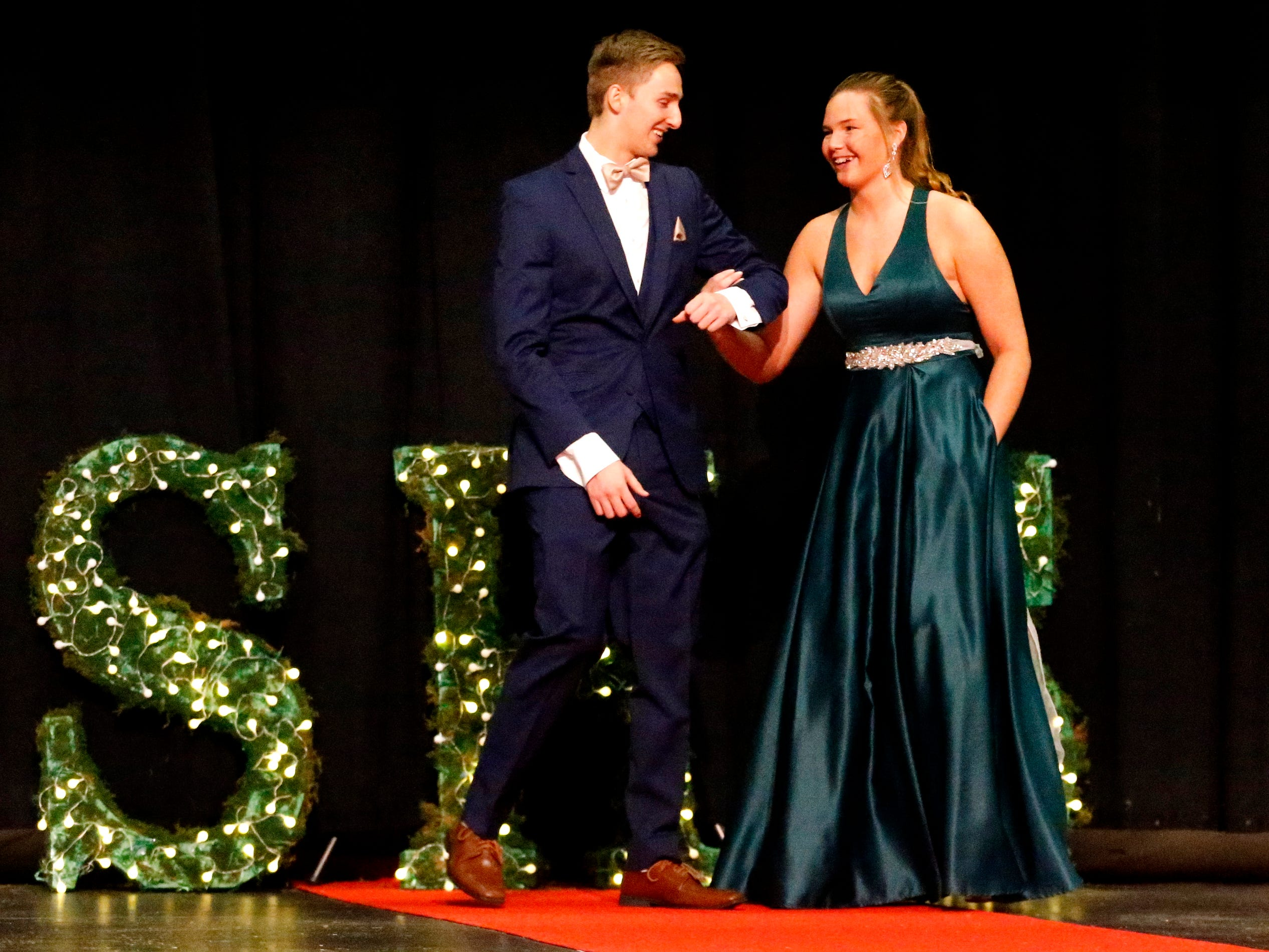Tyler Erdman, left and Taylor Patterson, right show off the latest in prom fashions during the Siegel Prom Fashion show on Thursday, Feb. 14, 2019.