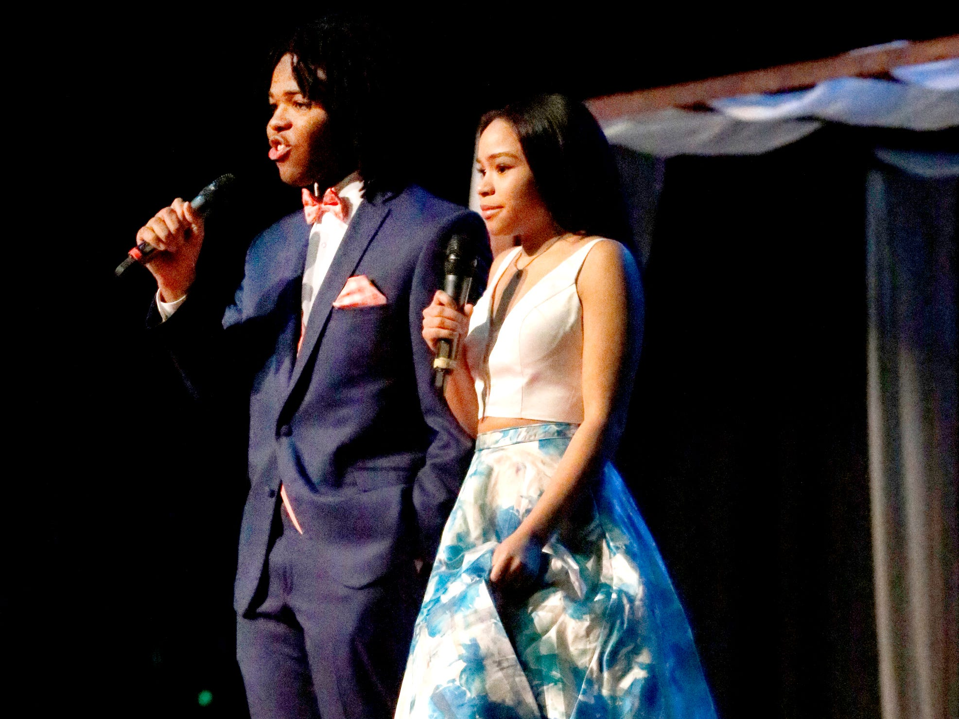 Malcom Bryant, left and Mya McDaniels, right show off the latest in prom fashions while they MC the Siegel Prom Fashion show on Thursday, Feb. 14, 2019.