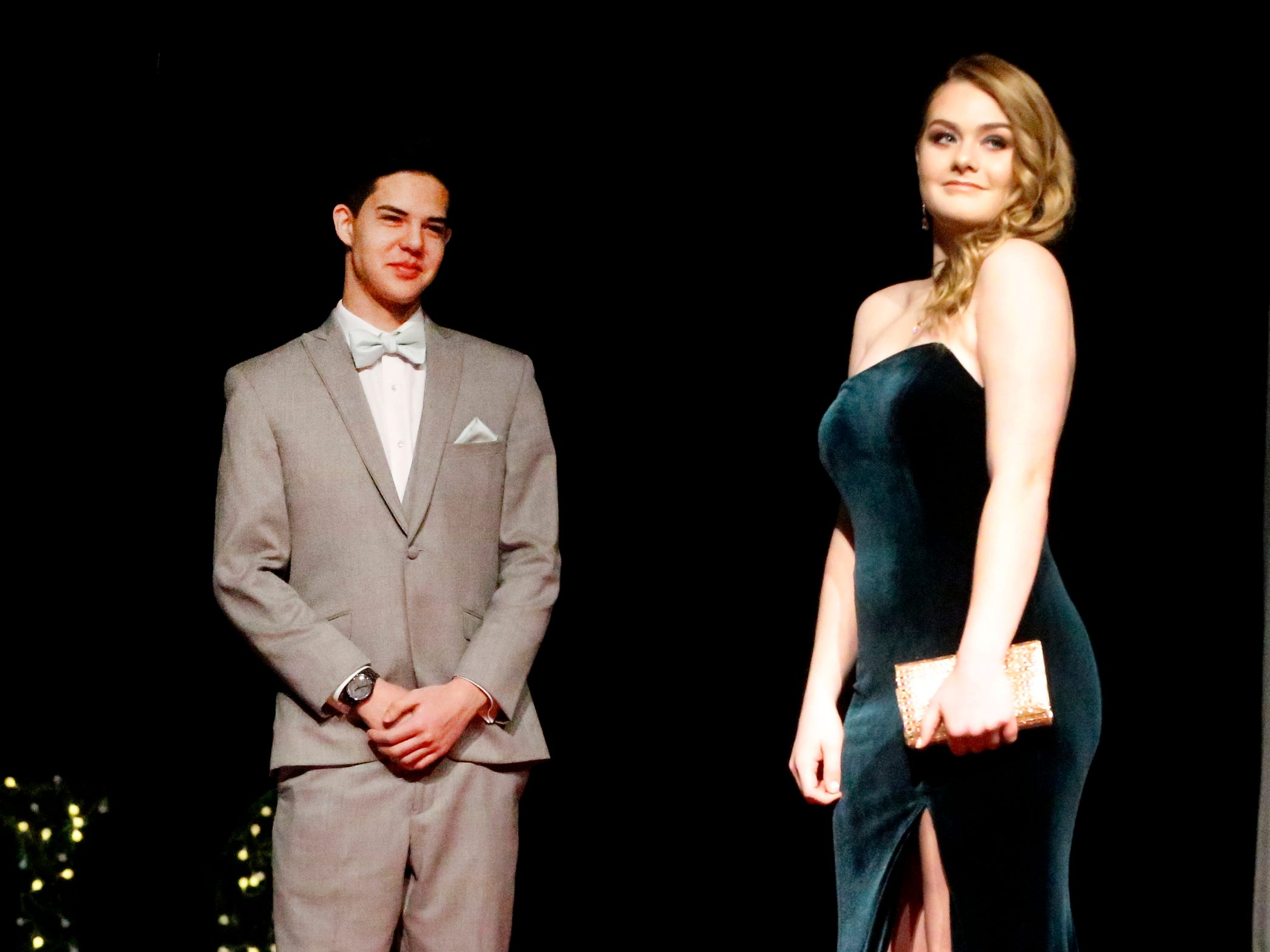 Courtney Donnelly steps forward to show off her dress as Tristian Cunningham waits to show off his tux during the Siegel Prom Fashion show on Thursday, Feb. 14, 2019.